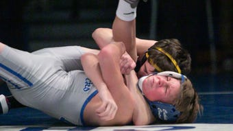 Sights, sounds and interviews from the school assembly dual wrestling match between Hartland and Detroit Catholic Central.