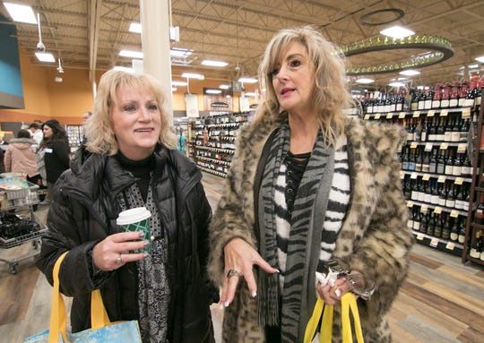 Kroger customers Sue Krause, left, and Sandy Rachwal are impressed with what the newly renovated Brighton store has to offer. They attended a ribbon cutting Wednesday, Dec. 5, 2018.