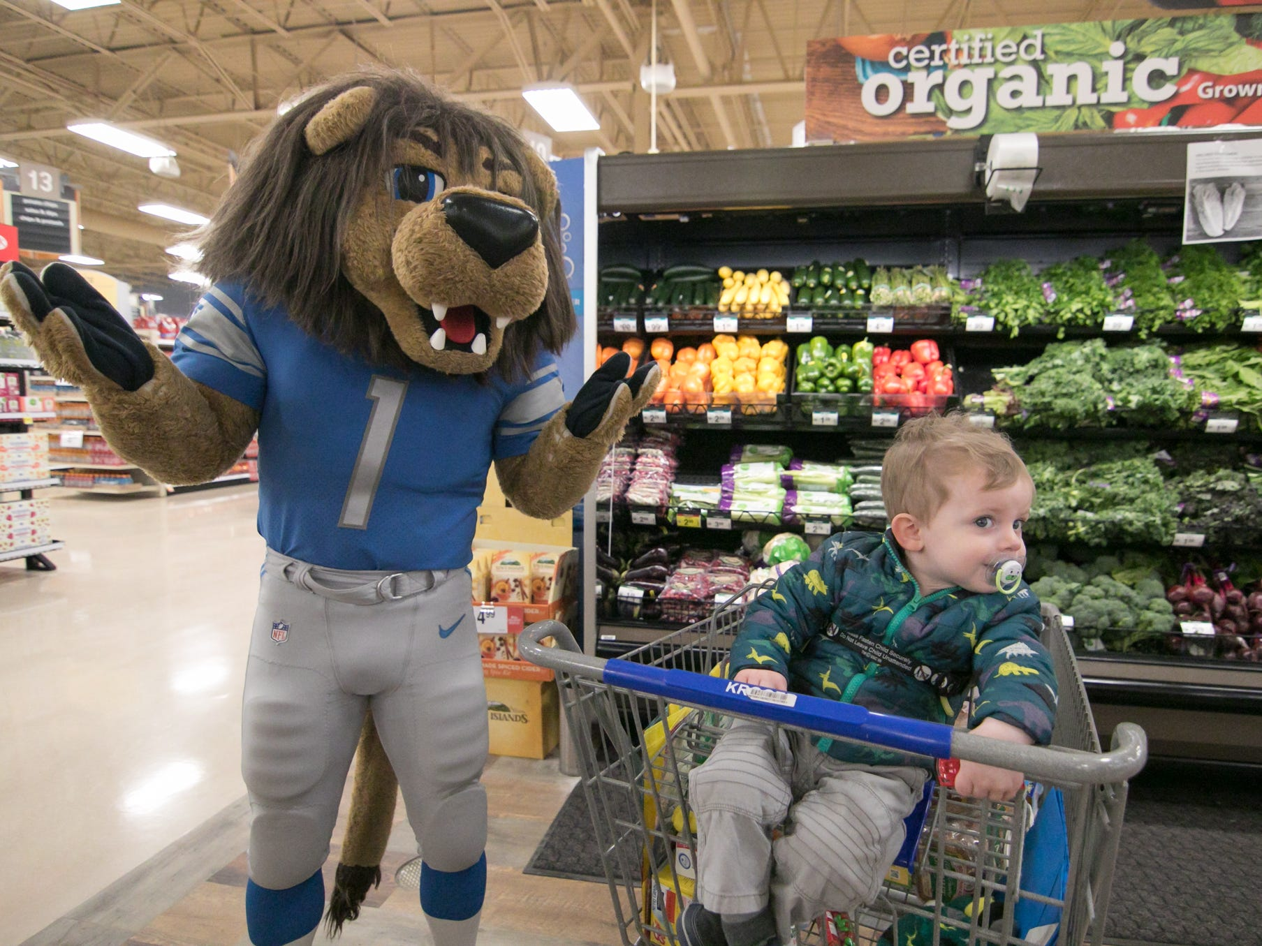 Detroit Lions mascot Roary couldn't hold the gaze of 23-month-old Wylan Zmikly at the expansion celebration of the Brighton Kroger store Wednesday, Dec. 5, 2018.