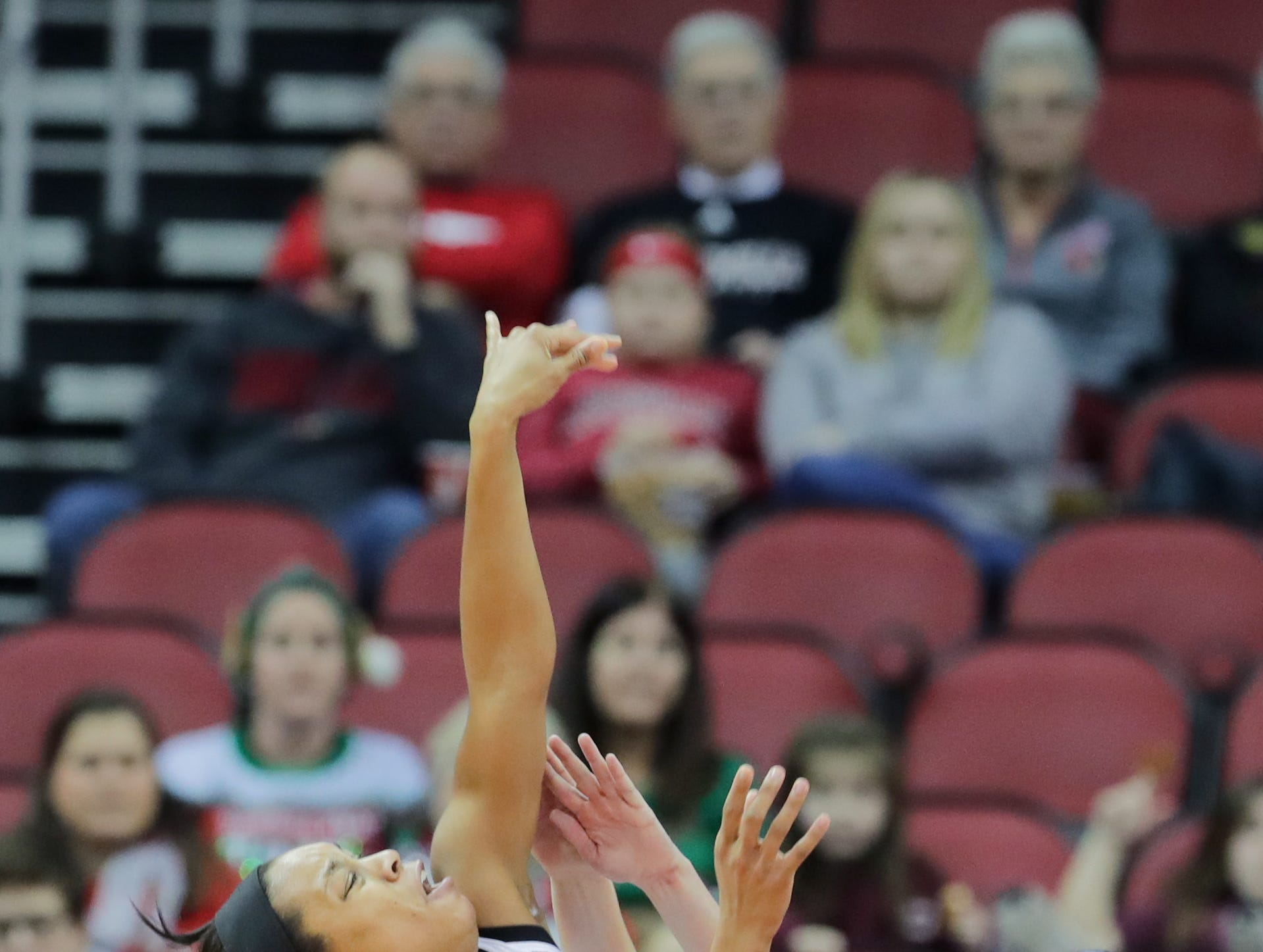 Louisville's Asia Durr is fouled while taking a shot.  