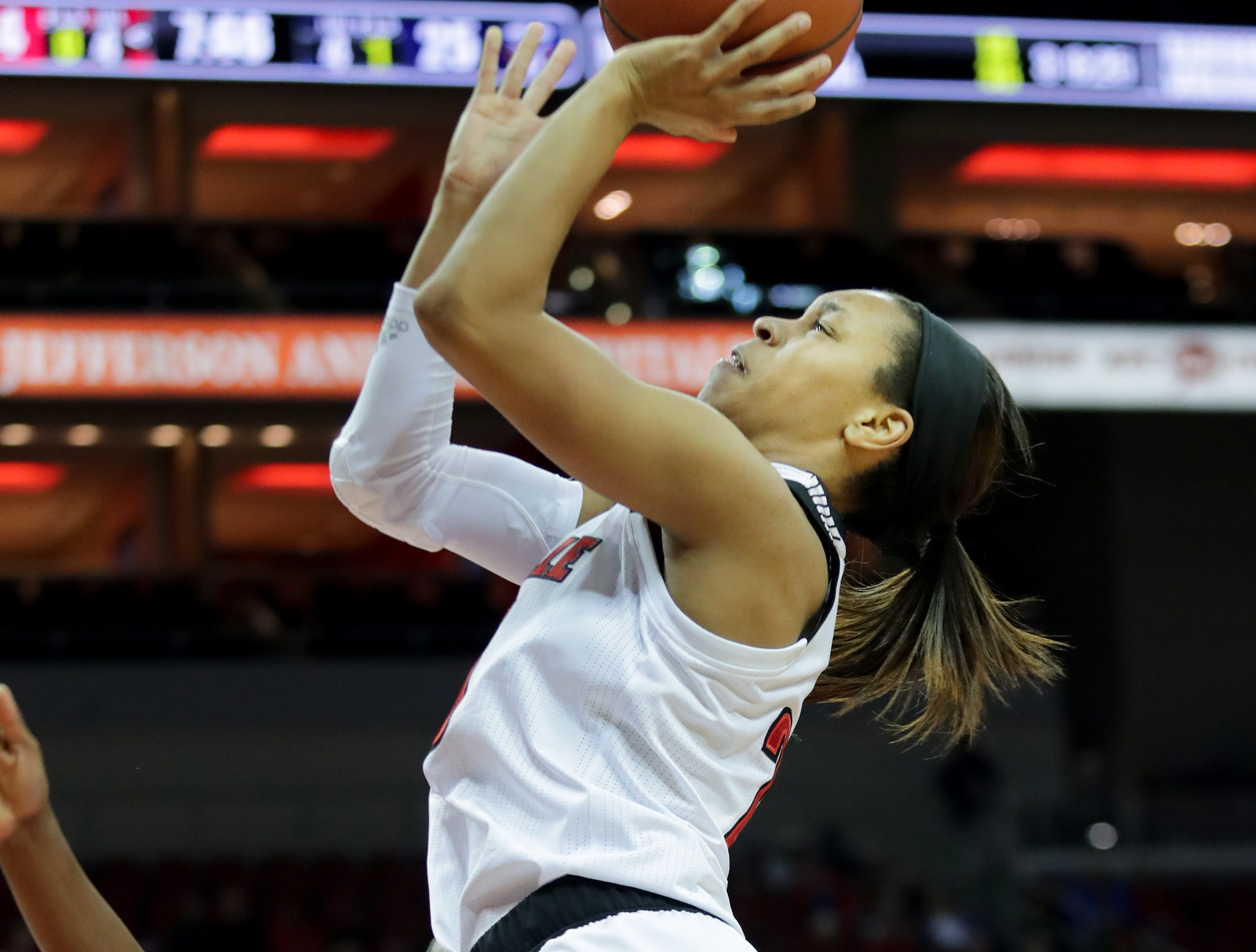 Louisville's Asia Durr pulls up for the two.Dec. 4, 2018