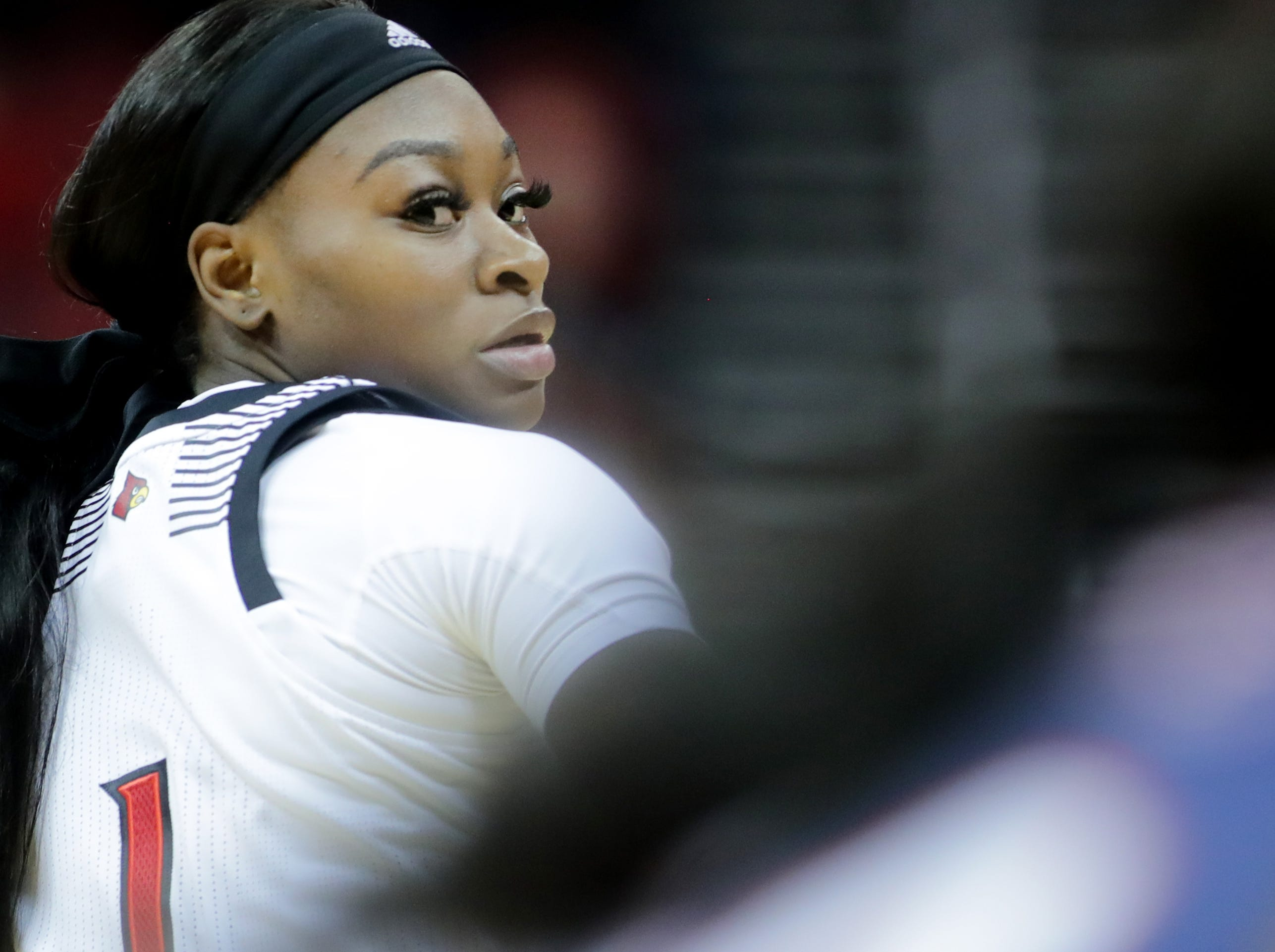 Louisville's Dana Evans follows the ball as it goes up court.  Dec. 4, 2018