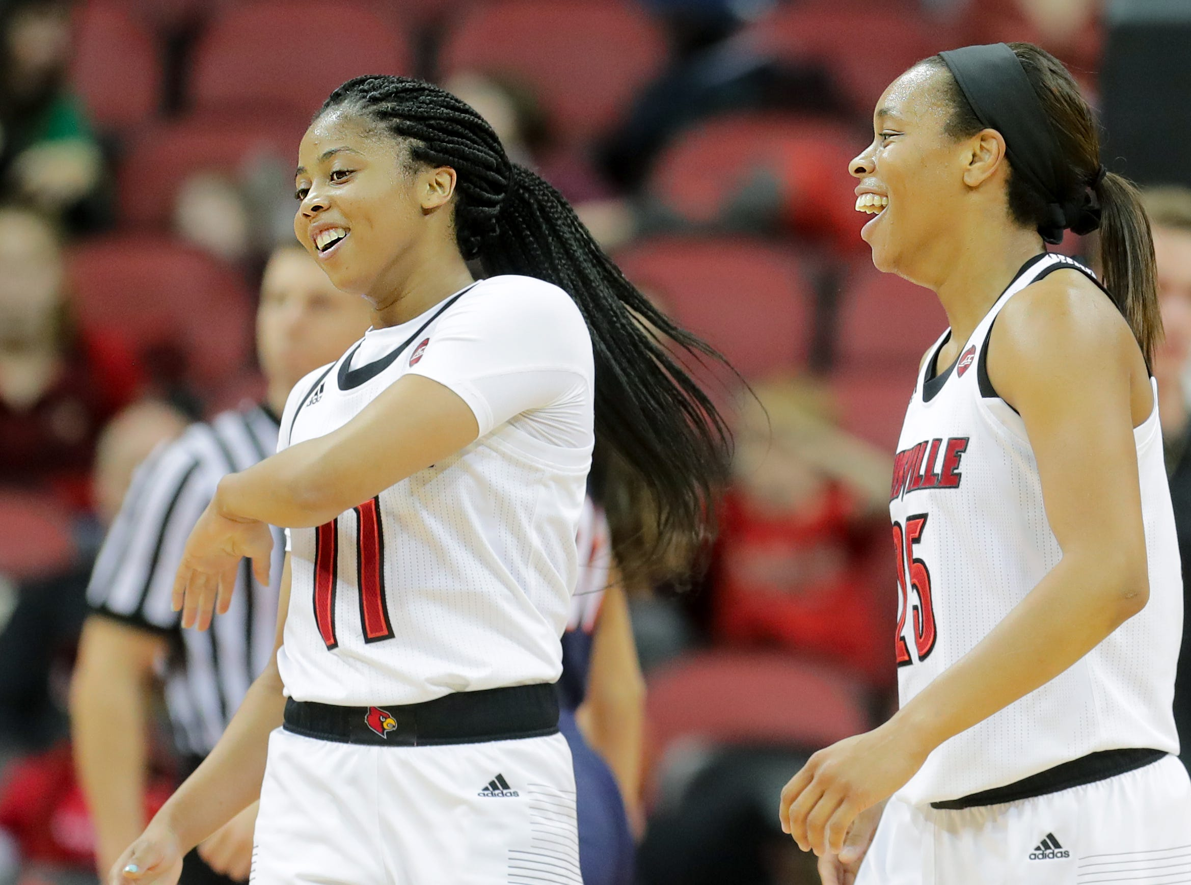 Louisville's Asia Durr, right, and Arica Carter share a laugh.   