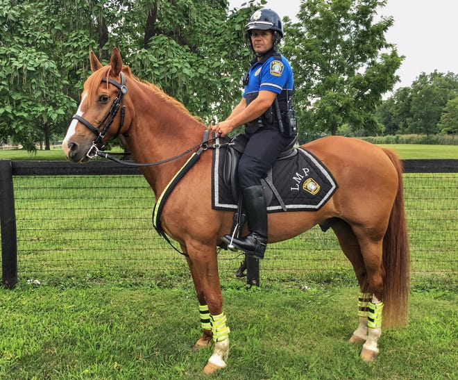 Lexington police horse Yoder and his rider.