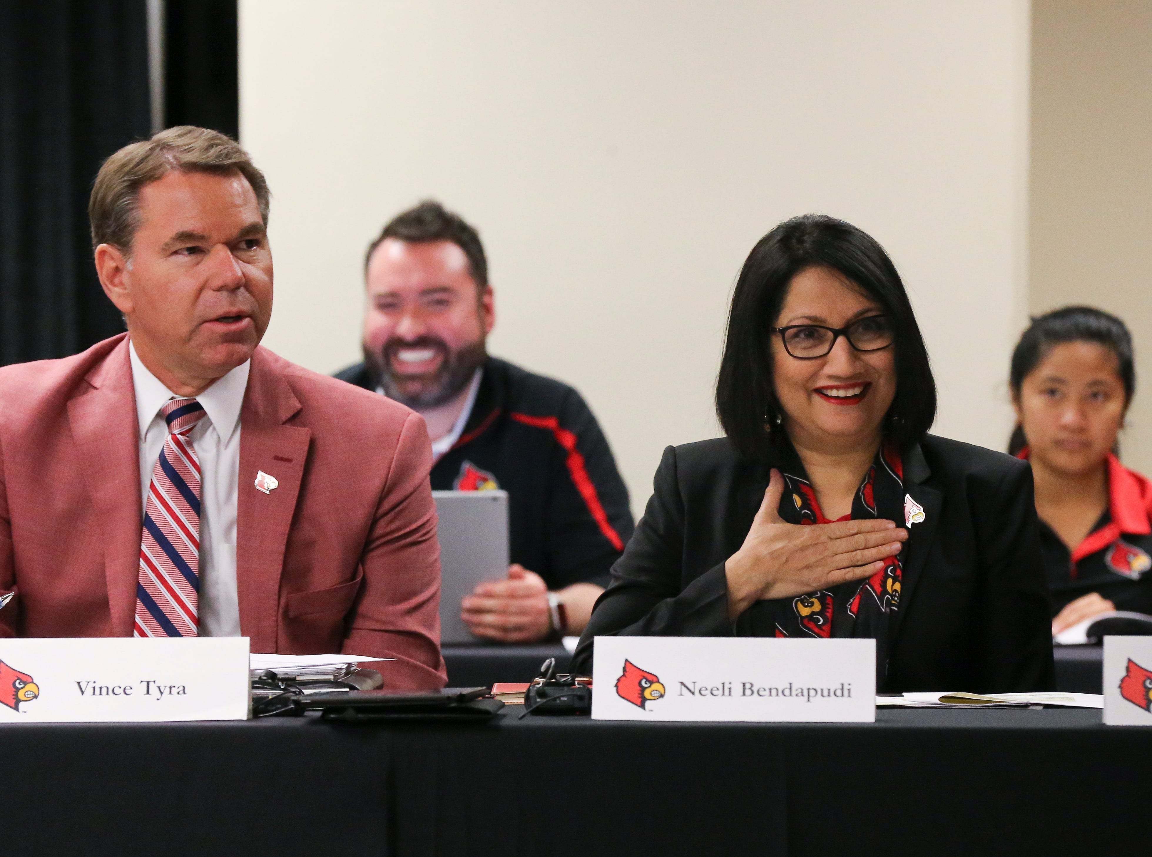 University of Louisville President Neeli Bendapudi, right, conducted the University of Louisville Athletic Association meeting as athletic director Vince Tyra sat next to her before approving Scott Satterfield as the new U of L head football coach at Cardinal Stadium.  Dec. 4, 2018