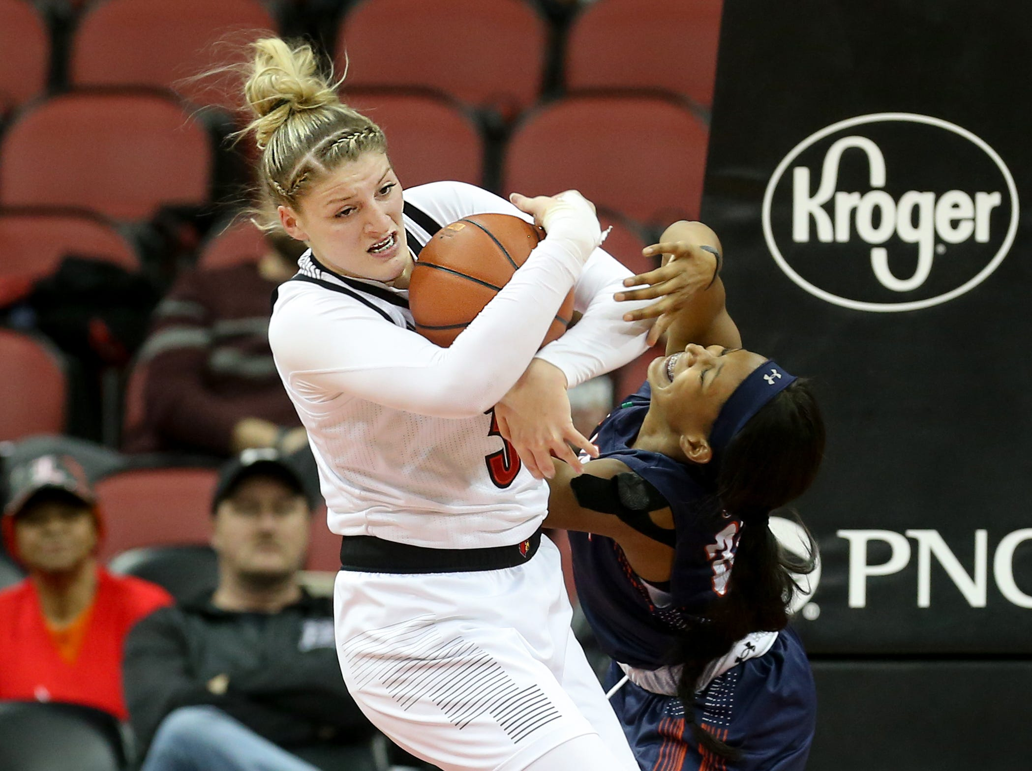 Louisville's Sam Fuehring fights for the ball with UT Martin's Chelsey Perry.    Dec. 4, 2018