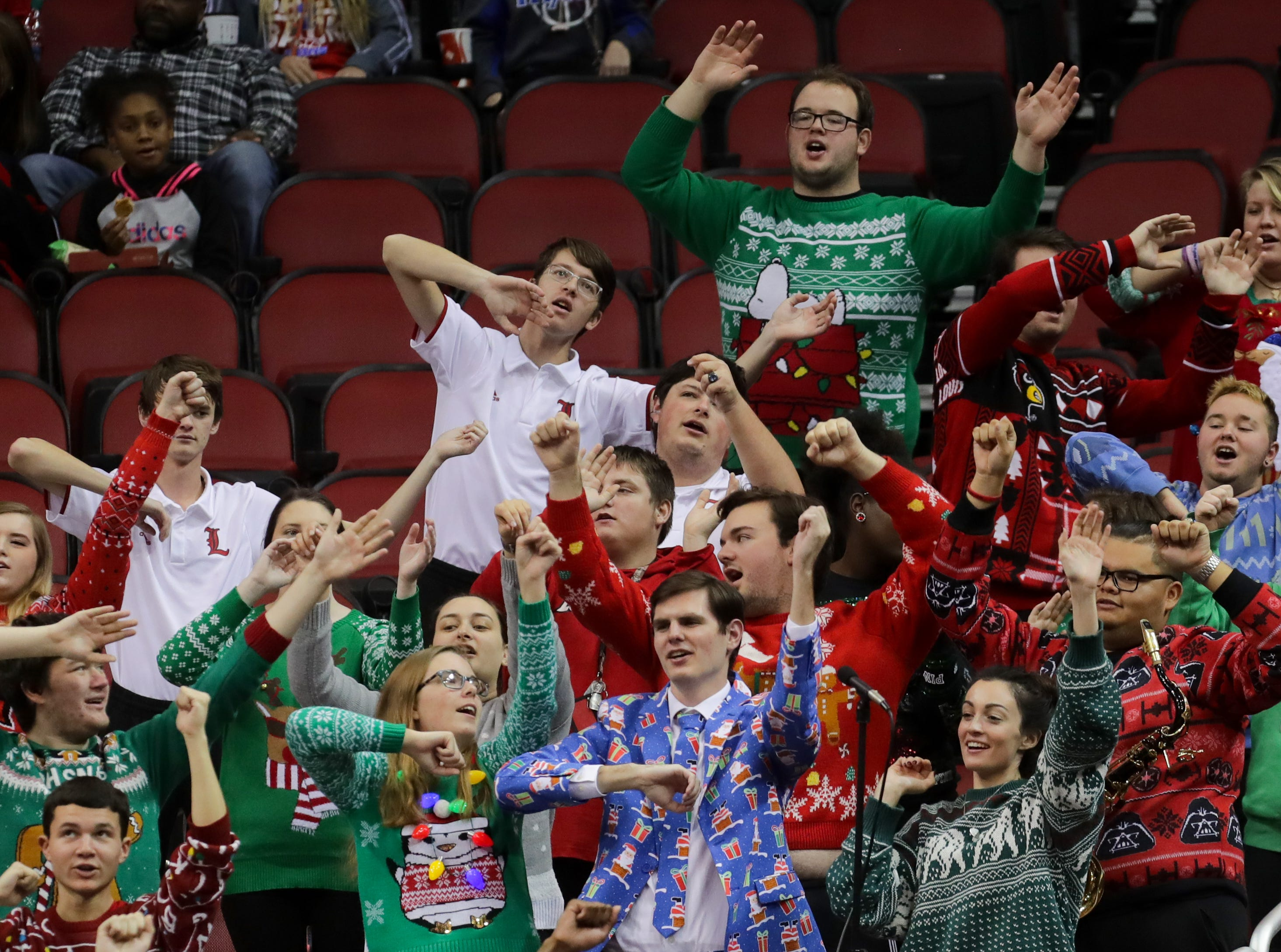 Many of the fans, including the pep band, at the Louisville vs UT Martin joined in on the Ugly Christmas Sweater night.   