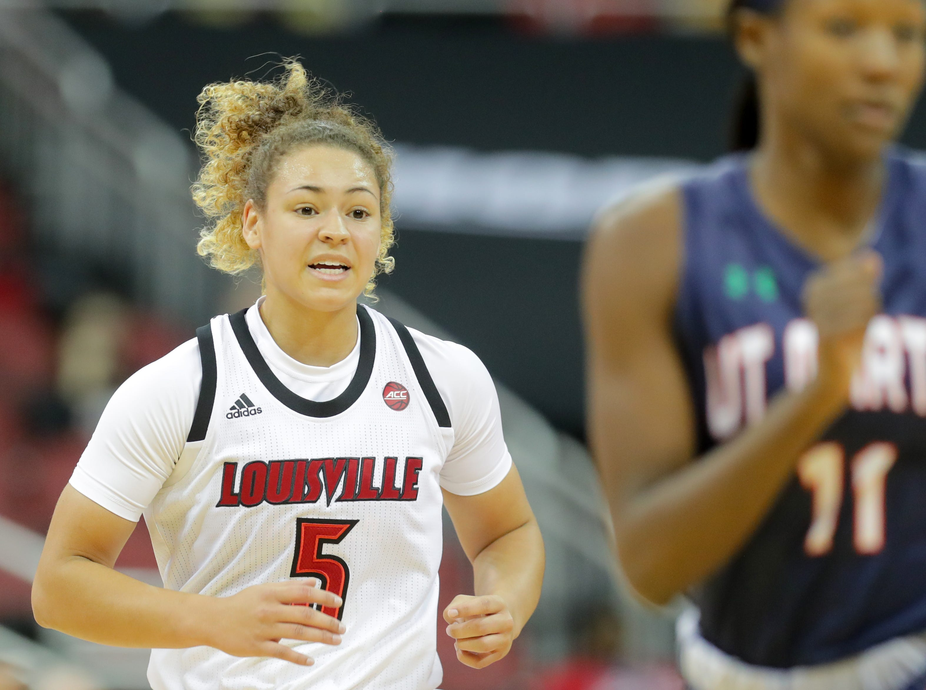 Louisville's Mykasa Robinson makes her way up court.
