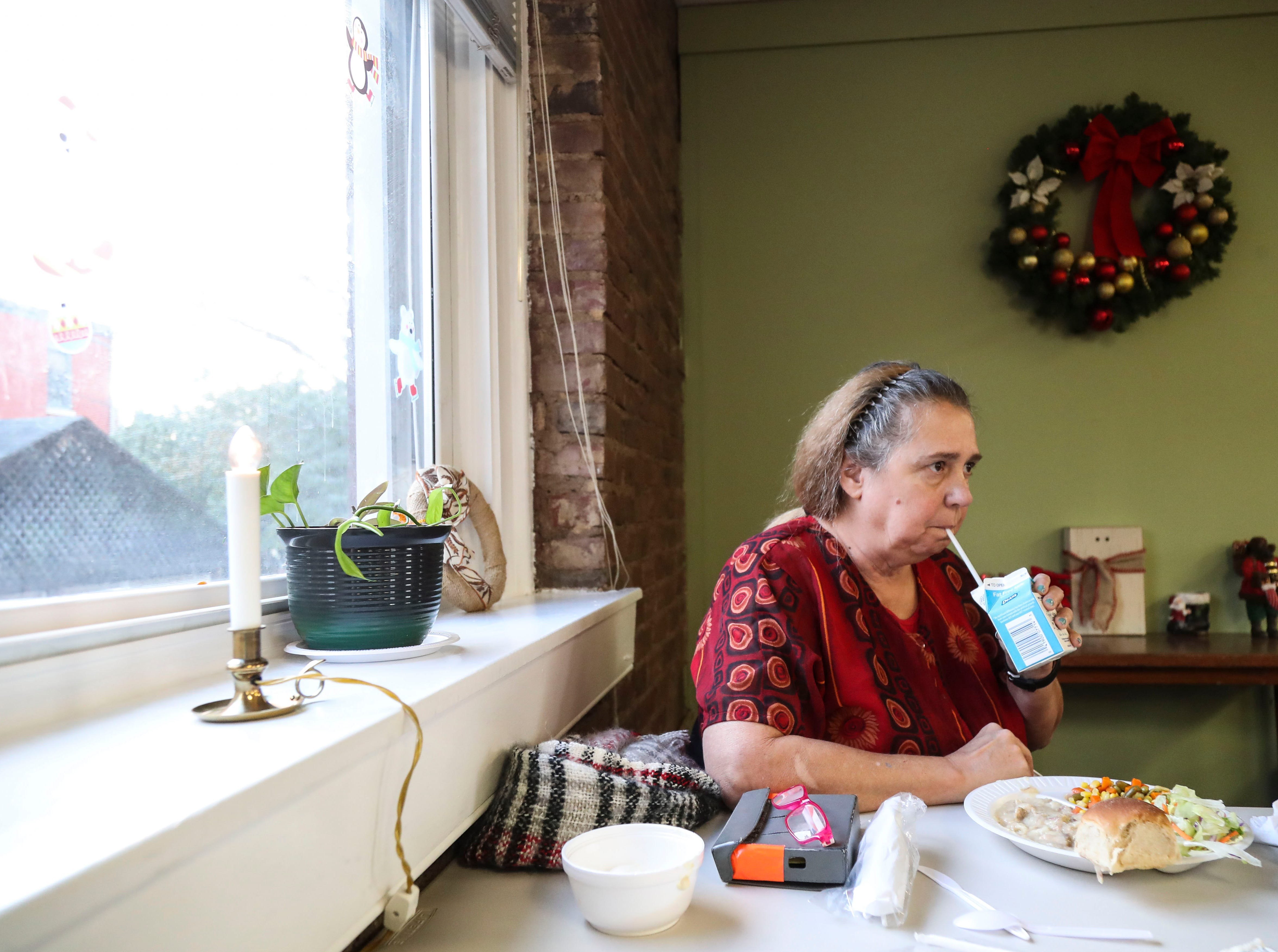 Michele Dutcher, 64, eats lunch for 50 cents at the Kling Center in Old Louisville several times a week. It's a chance for her to get a decent meal as well as socialize.