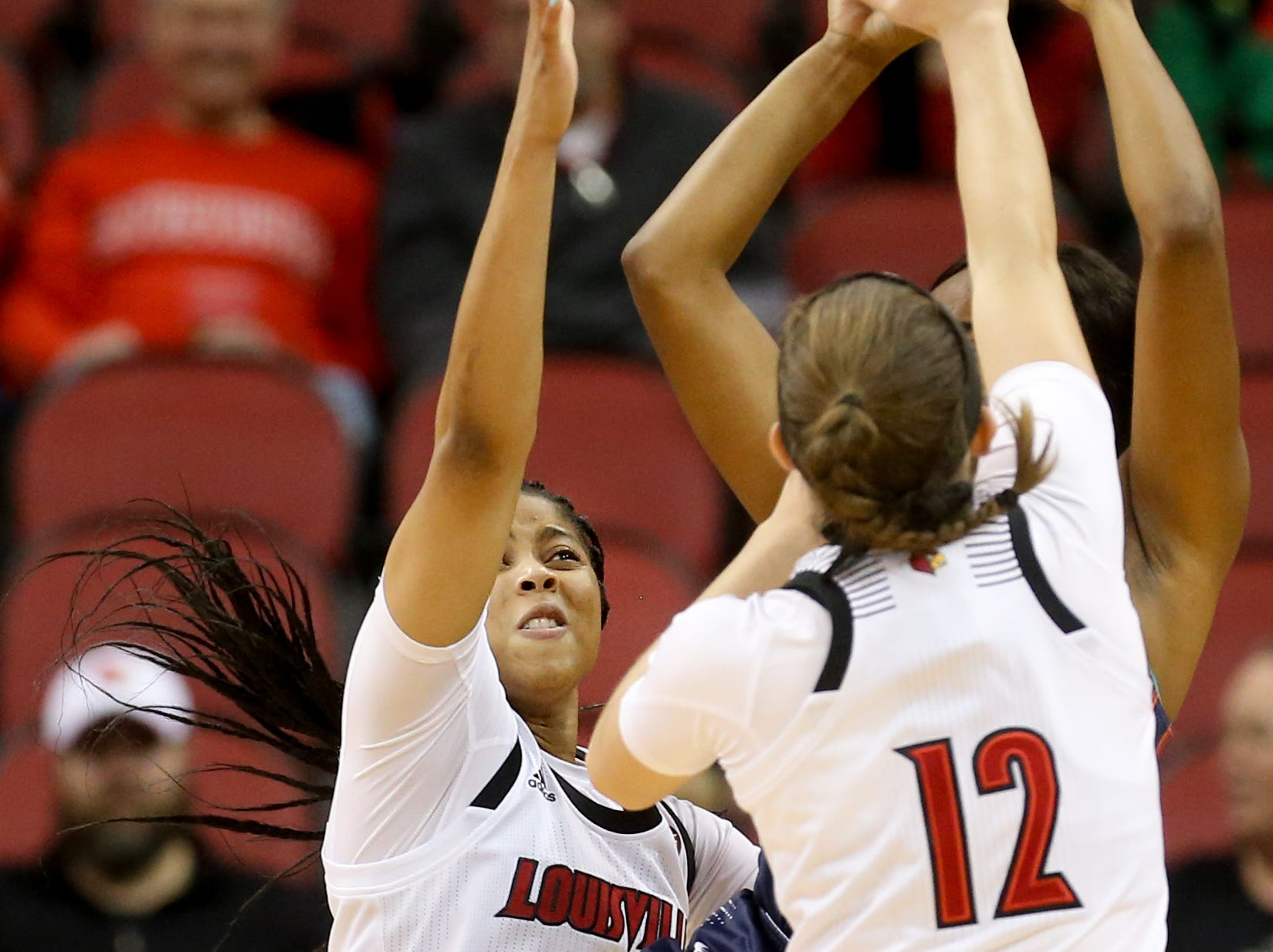 Louisville's Arica Carter and Lindsey Duvall smother a UT Martin player.     Dec. 4, 2018