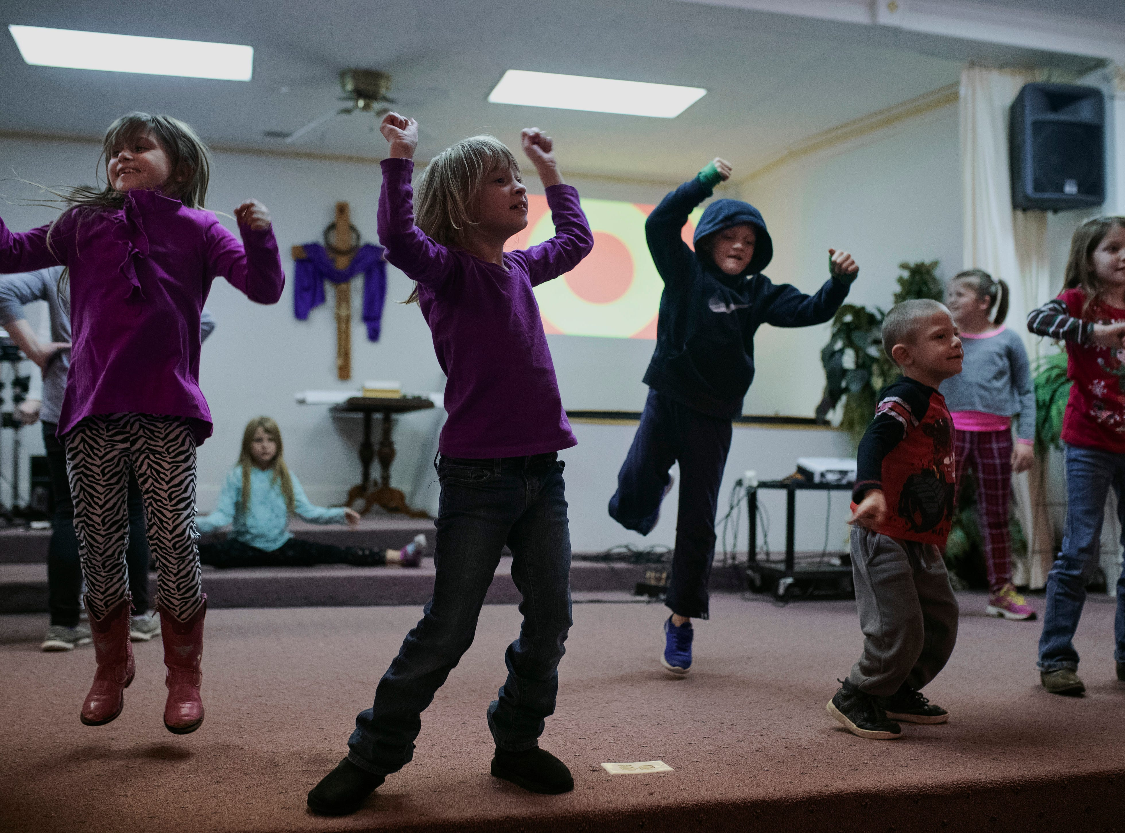 Children dance to christian music inside Hope To Others Church on Austin's north side during a Thursday youth program. The church is heavily involved with youth in the area, but also host numerous weekly recovery and NA meetings. Nov. 29, 2018
