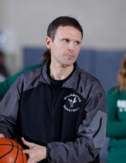 Williamston coach Pete Cool is shown against East Lansing, Tuesday, Dec. 4, 2018, in East Lansing, Mich.
