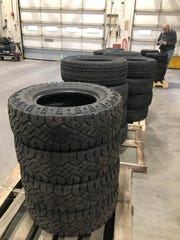 New tires stacked at the state of Michigan's Surplus Store on Wednesday, Dec. 5 will be part of a four-hour sale on Dec. 8.