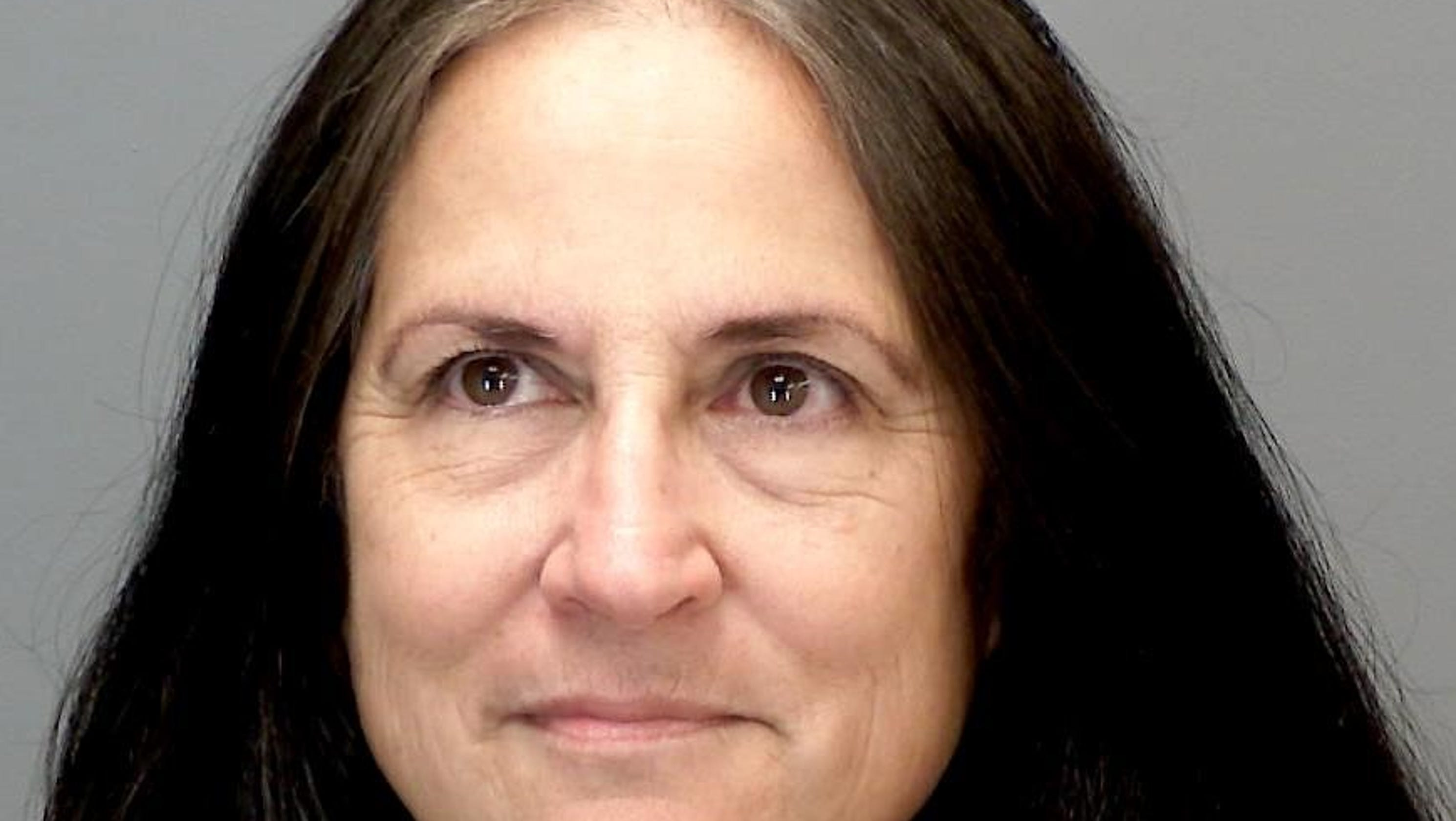 Holt woman charged with not paying taxes on money in