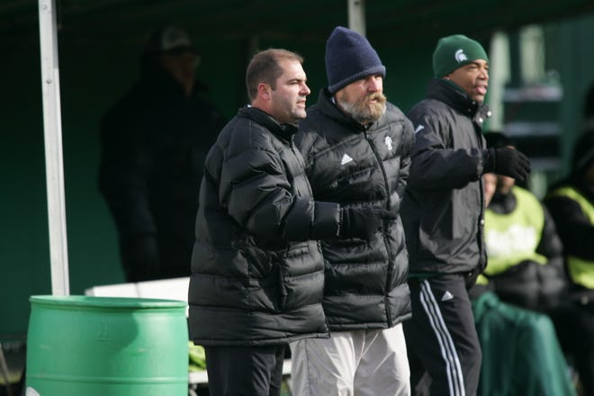Damon Rensing, left, and Joe Baum, middle, share the sideline together in this undated photo. Rensing was Baum's assistant for 10 years before taking over in the 2009 season.