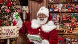 Community center hosts a free meet-and-greet with Black Santa that offers children opportunity to share holiday wishes with a yuletide icon of color.