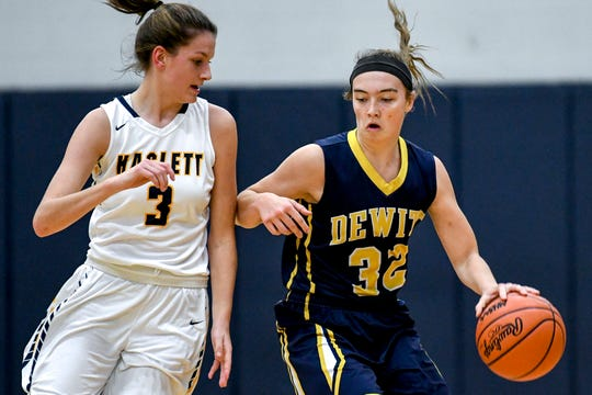 DeWitt's Maddie Petersen, right, moves with the ball as Haslett's Brooke Bradley defends during the first quarter on Tuesday, Dec. 4, 2018, at Haslett High School.