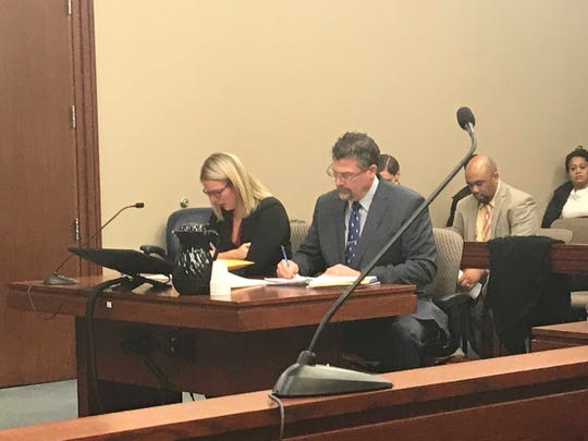 Allyson Moran, left, cries as she listens to a victim impact statement given by the mother of the boy she sexually assaulted.
