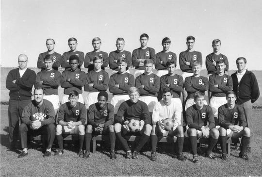 The 1967 Michigan State soccer team, which shared the national championship with Saint Louis. Joe Baum is in the middle of the front row, holding the ball.