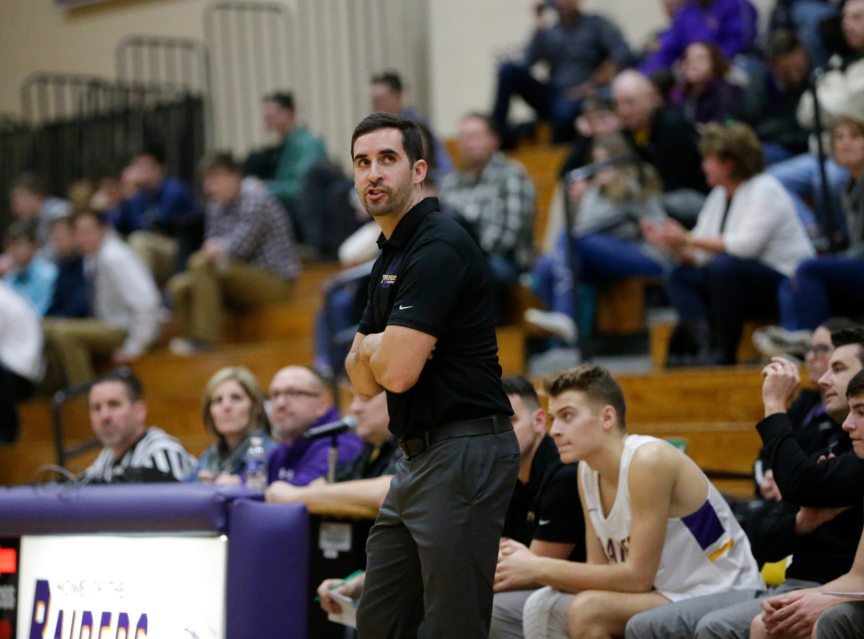 Two Rivers' head coach Nick Spencer looks at the scoreboard as the Raiders fall behind Sheboygan Falls during an Eastern Wisconsin Conference game at Two Rivers High School Tuesday, December 4, 2018, in Two Rivers, Wis. Joshua Clark/USA TODAY NETWORK-Wisconsin
