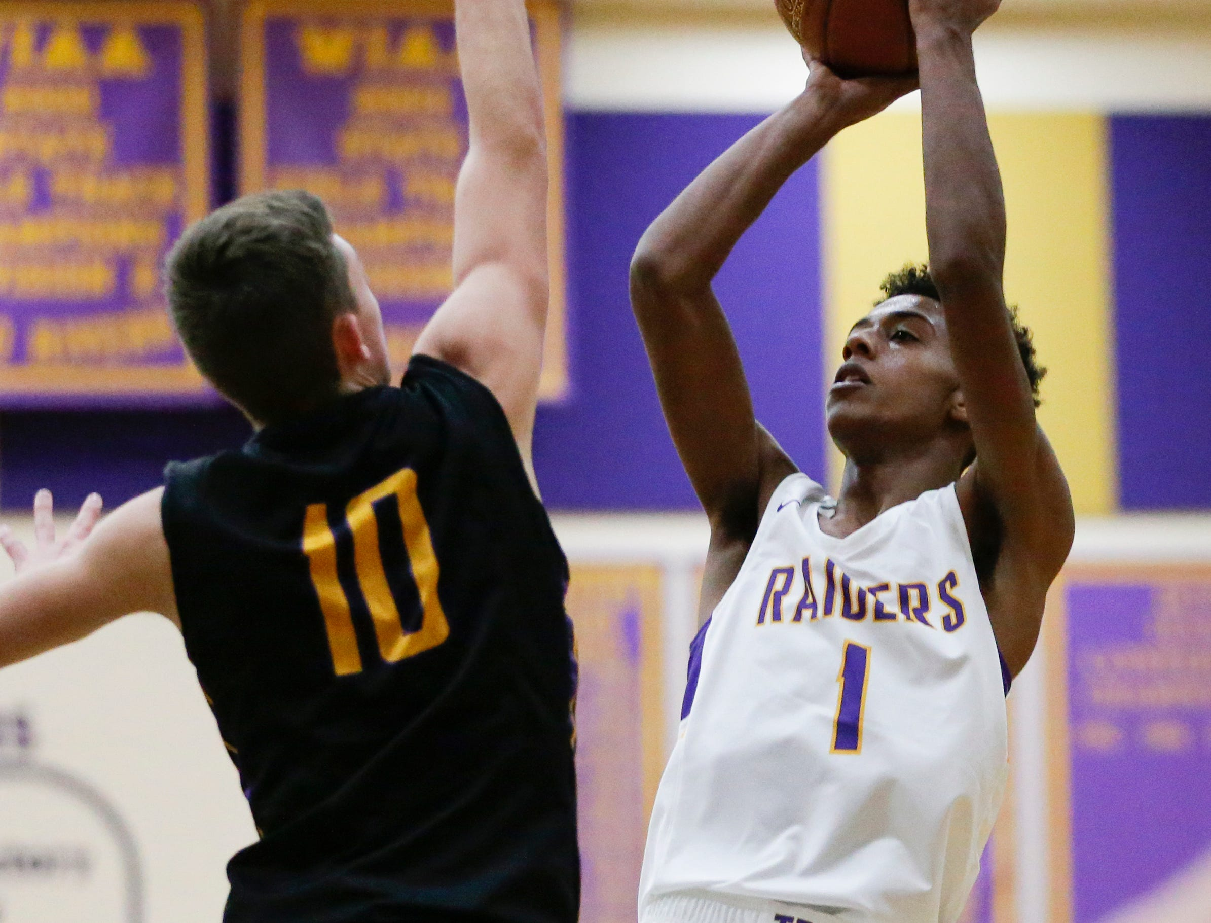 Two Rivers' Isaac Coronado puts up a shot over Sheboygan Falls' Justin Tenpas during an Eastern Wisconsin Conference game at Two Rivers High School Tuesday, December 4, 2018, in Two Rivers, Wis. Joshua Clark/USA TODAY NETWORK-Wisconsin