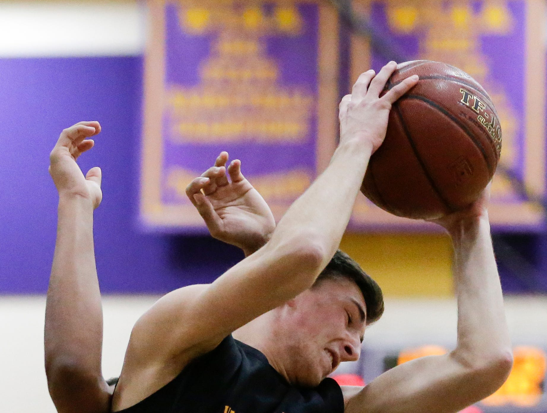 Sheboygan Falls' Justin Tenpas grabs a rebound against Two Rivers during an Eastern Wisconsin Conference game at Two Rivers High School Tuesday, December 4, 2018, in Two Rivers, Wis. Joshua Clark/USA TODAY NETWORK-Wisconsin