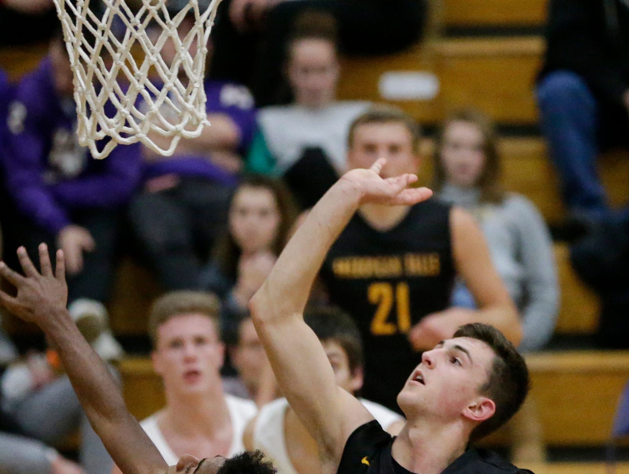 Sheboygan Falls' Justin Tenpas shoots a layup against Two Rivers during an Eastern Wisconsin Conference game at Two Rivers High School Tuesday, December 4, 2018, in Two Rivers, Wis. Joshua Clark/USA TODAY NETWORK-Wisconsin