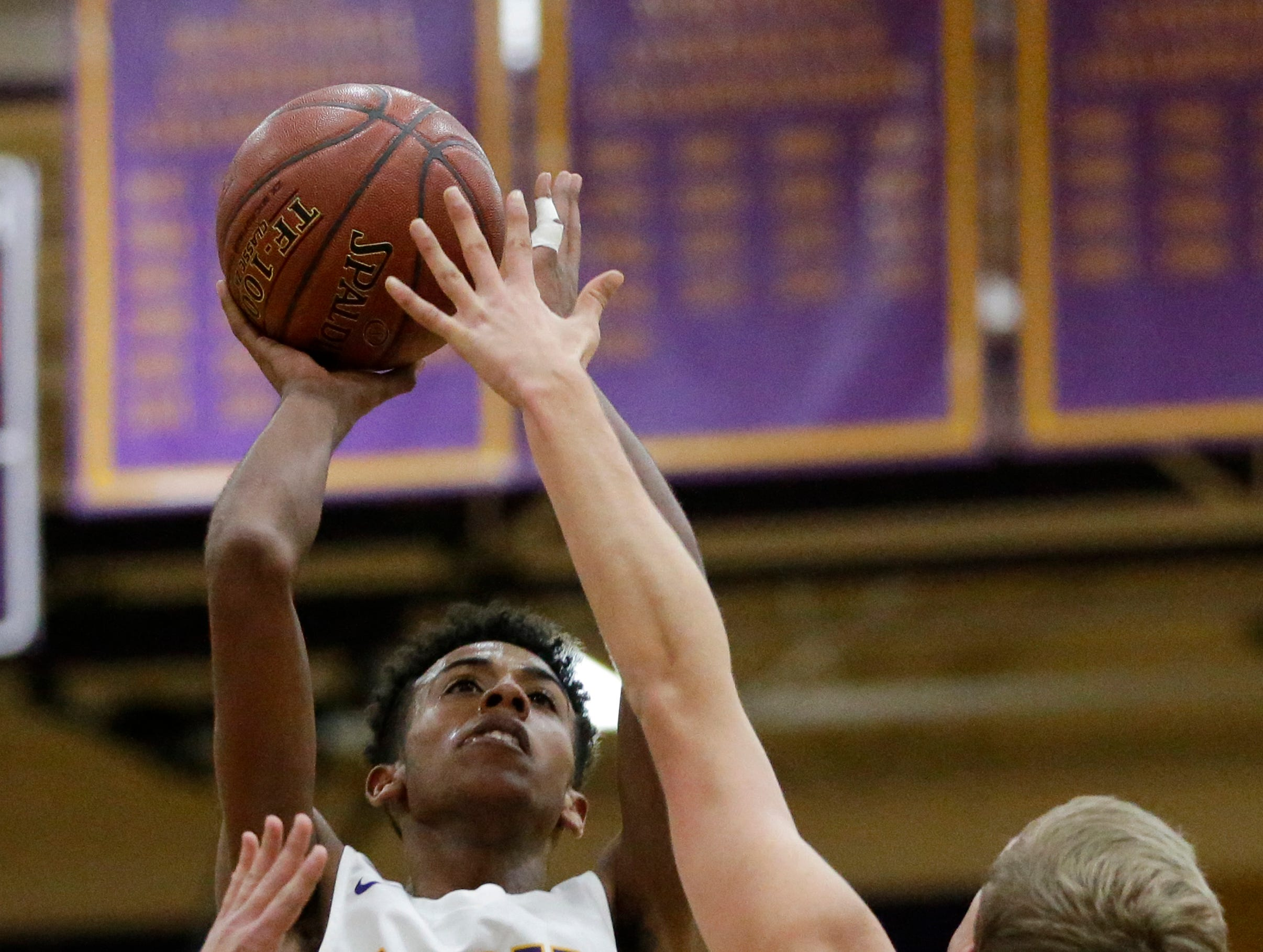 Two Rivers' Isaac Coronado puts up a shot over Sheboygan Falls' Bryce Peterson during an Eastern Wisconsin Conference game at Two Rivers High School Tuesday, December 4, 2018, in Two Rivers, Wis. Joshua Clark/USA TODAY NETWORK-Wisconsin