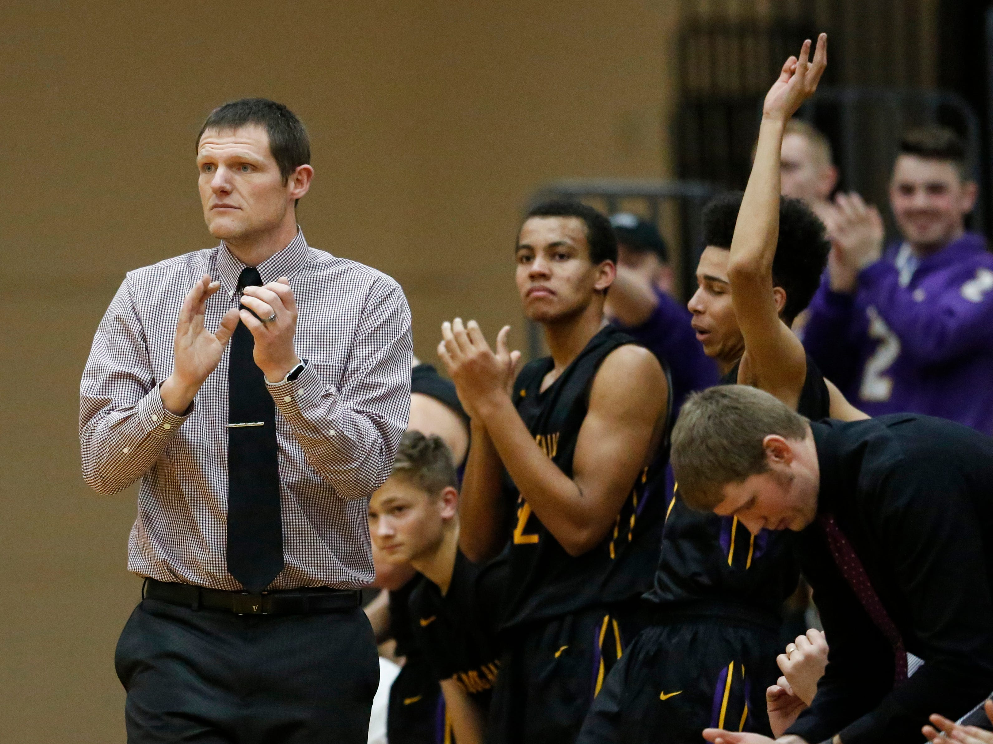 Sheboygan Falls' head coach Jake Frohling claps after they score against Two Rivers during an Eastern Wisconsin Conference game at Two Rivers High School Tuesday, December 4, 2018, in Two Rivers, Wis. Joshua Clark/USA TODAY NETWORK-Wisconsin