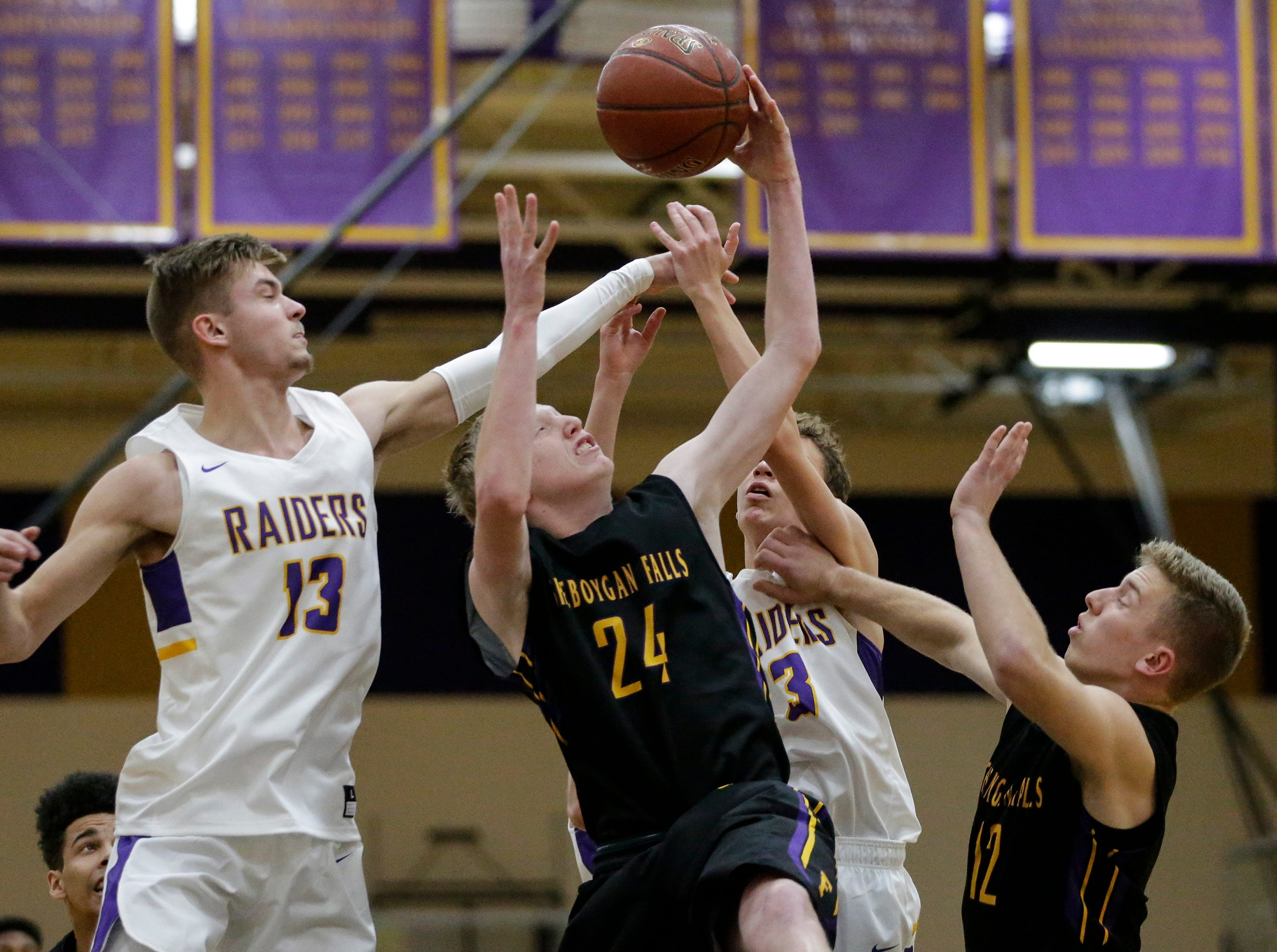 Sheboygan Falls' Isaac Klemme grabs a rebound against Two Rivers during an Eastern Wisconsin Conference game at Two Rivers High School Tuesday, December 4, 2018, in Two Rivers, Wis. Joshua Clark/USA TODAY NETWORK-Wisconsin