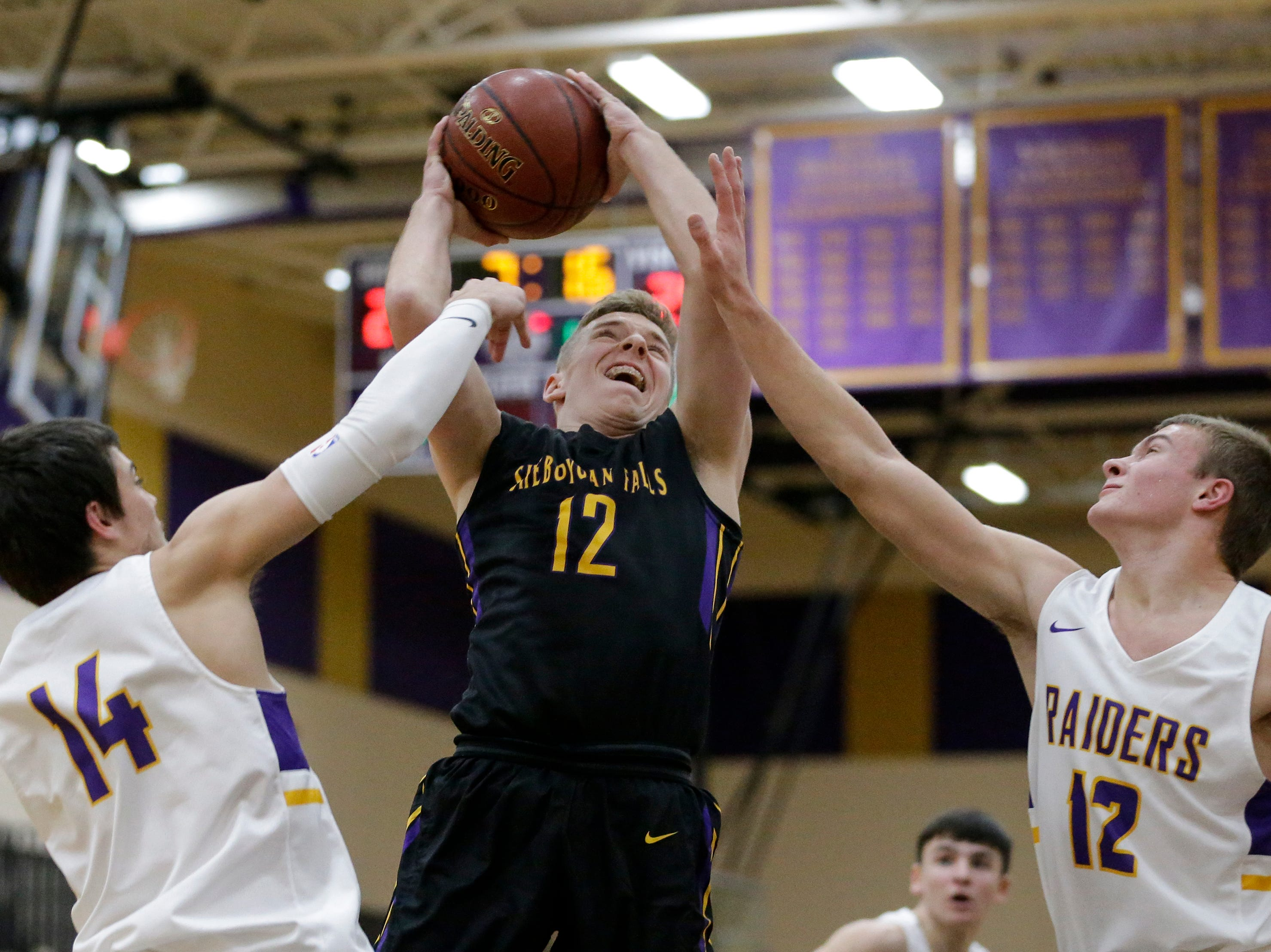 Sheboygan Falls' Langdon Thiel puts up a shot against Two Rivers during an Eastern Wisconsin Conference game at Two Rivers High School Tuesday, December 4, 2018, in Two Rivers, Wis. Joshua Clark/USA TODAY NETWORK-Wisconsin