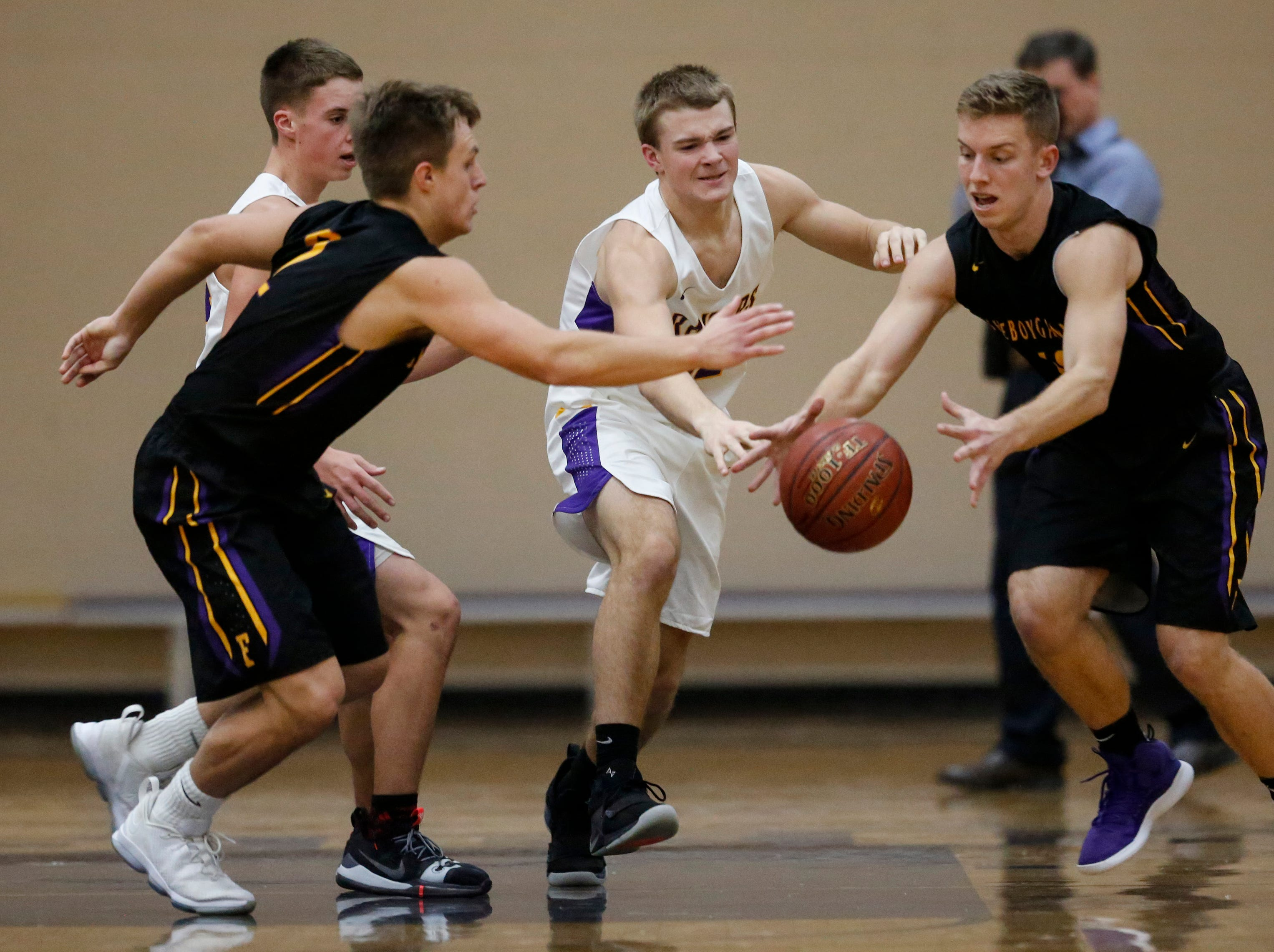 Two Rivers' Wilhelm Schmid (12) battles Sheboygan Falls' Alex Schmitt, left, and Langdon Thiel for a rebound during an Eastern Wisconsin Conference game at Two Rivers High School Tuesday, December 4, 2018, in Two Rivers, Wis. Joshua Clark/USA TODAY NETWORK-Wisconsin