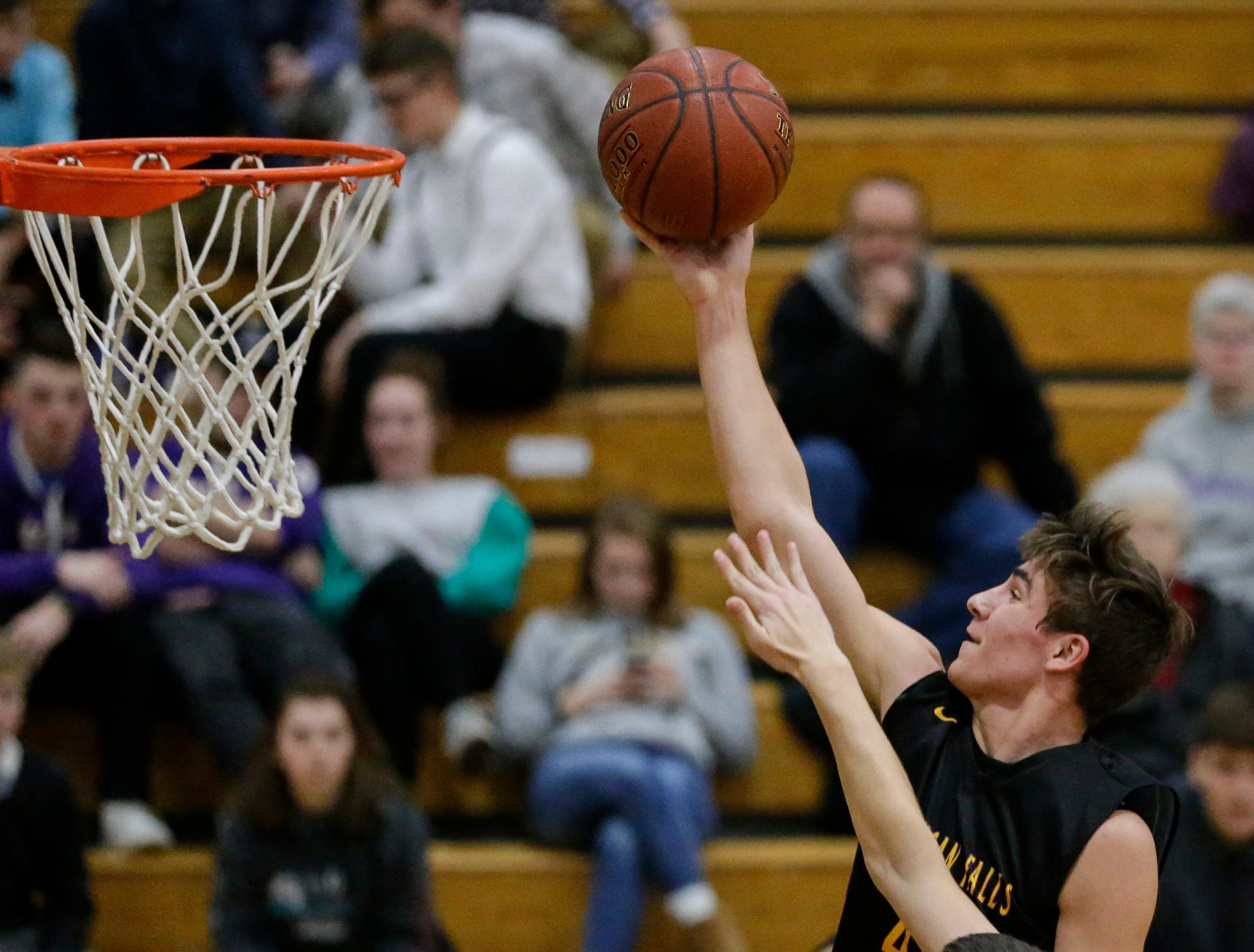 Sheboygan Falls' Jonathan Bassuener (4) takes it to the hoop against Two Rivers during an Eastern Wisconsin Conference game at Two Rivers High School Tuesday, December 4, 2018, in Two Rivers, Wis. Joshua Clark/USA TODAY NETWORK-Wisconsin