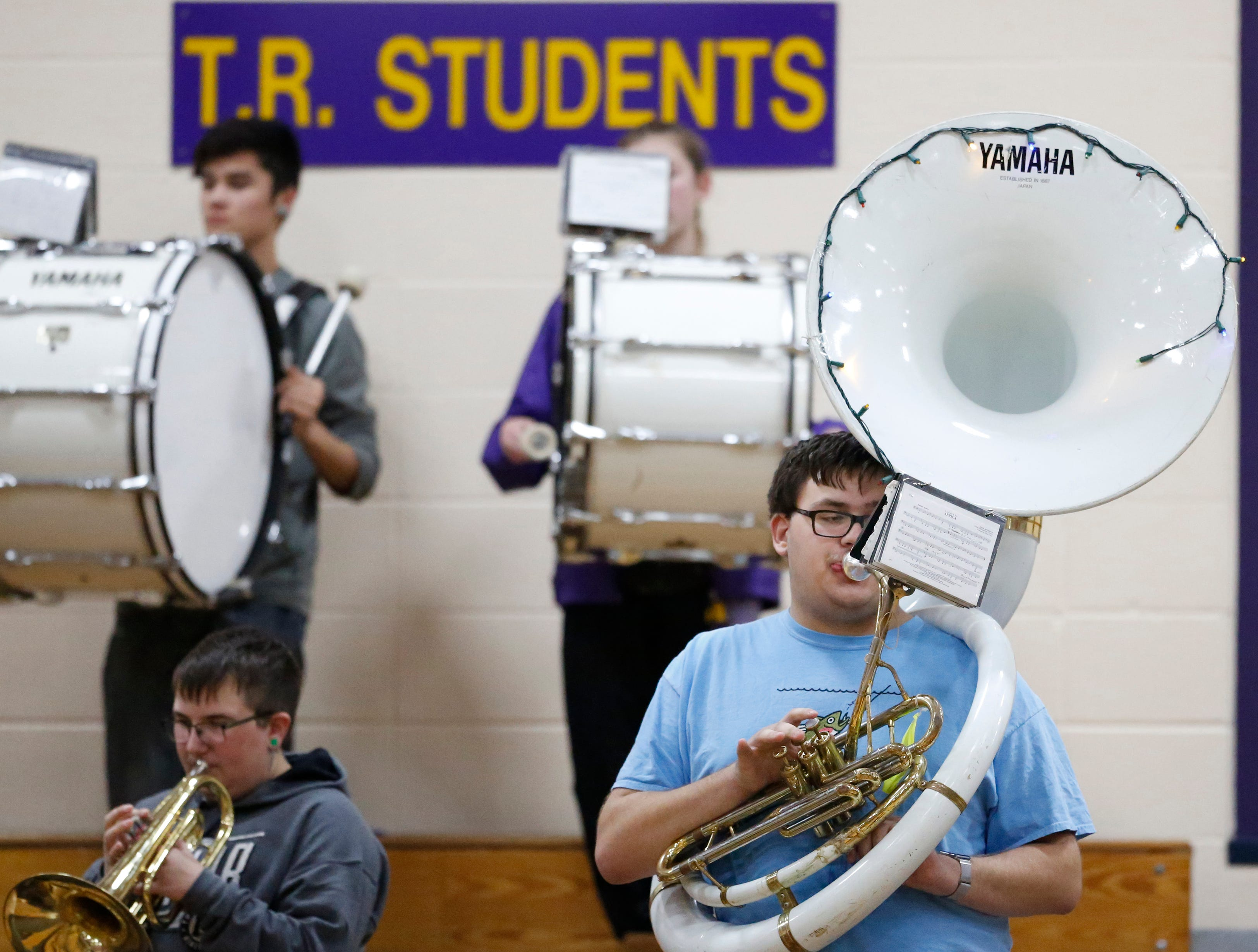 A Two Rivers tuba player gets festive by decorating his instrument with Christmas lights during a boys basketball game against Sheboygan Falls at Two Rivers High School Tuesday, December 4, 2018, in Two Rivers, Wis. Joshua Clark/USA TODAY NETWORK-Wisconsin