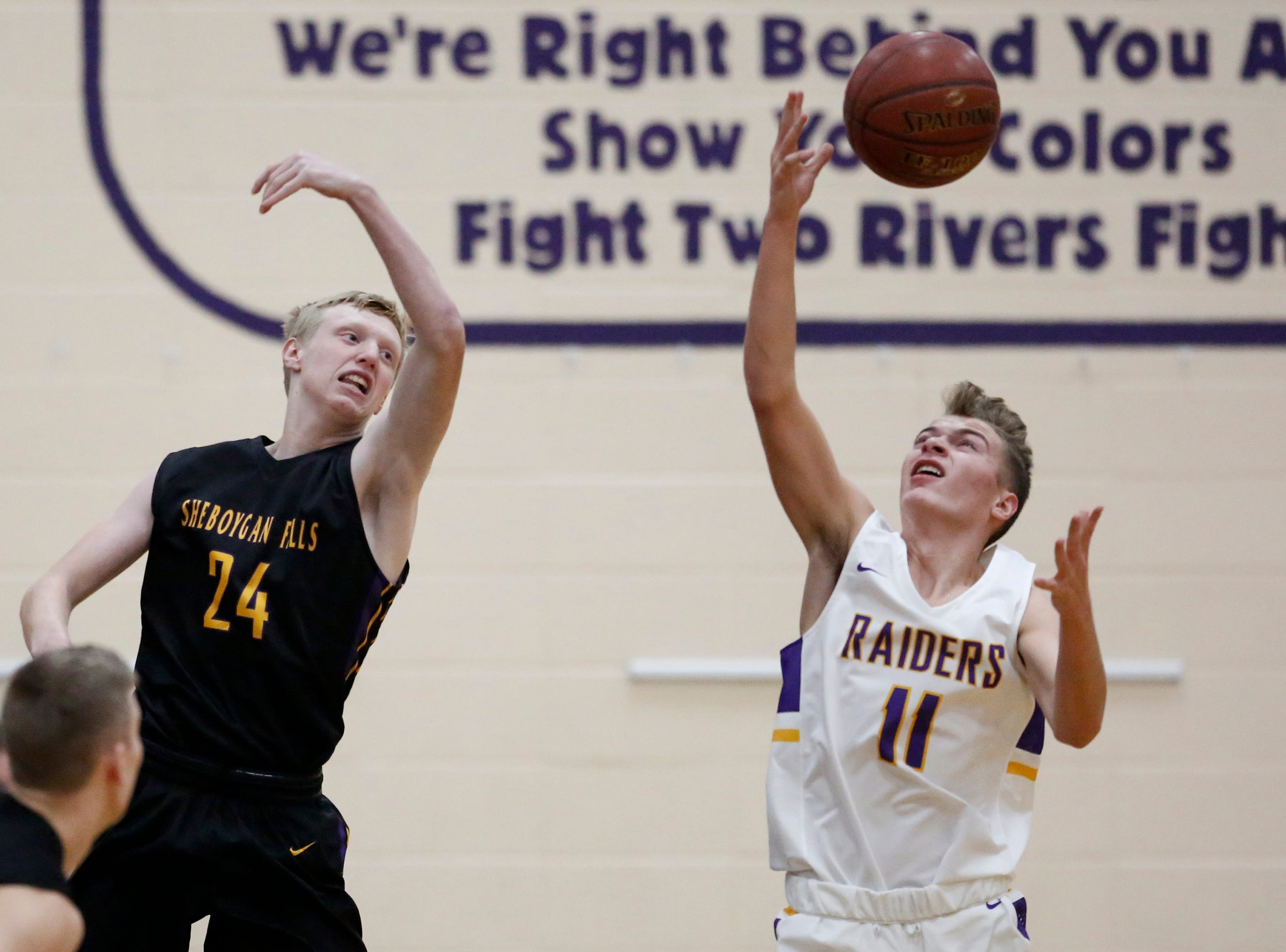 Two Rivers' Alexander Klein wins a rebound over Sheboygan Falls' Isaac Klemme during an Eastern Wisconsin Conference game at Two Rivers High School Tuesday, December 4, 2018, in Two Rivers, Wis. Joshua Clark/USA TODAY NETWORK-Wisconsin