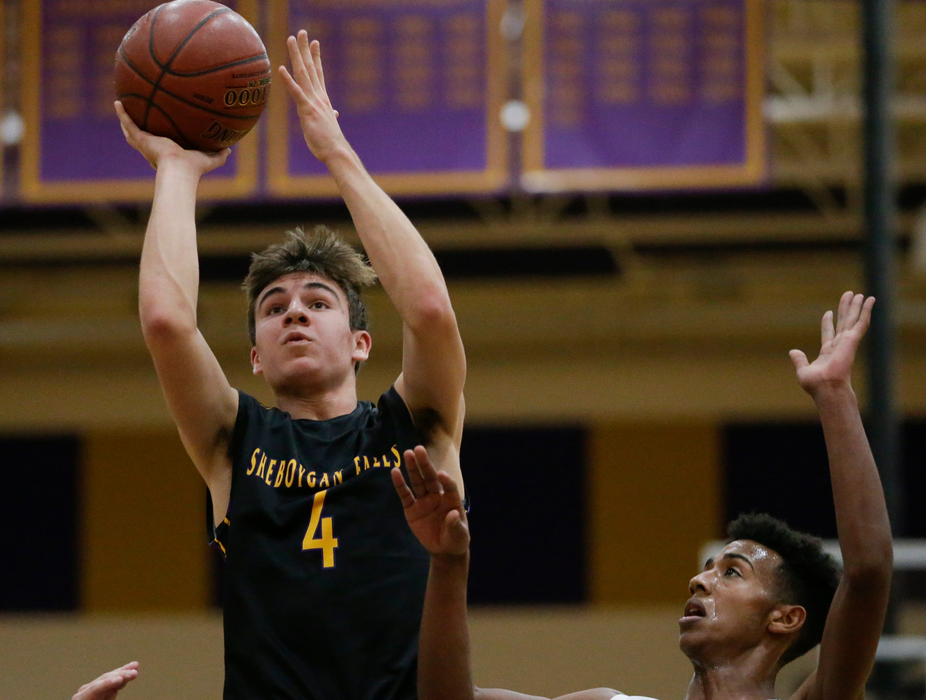 Sheboygan Falls' Jonathan Bassuener puts up a shot against Two Rivers during an Eastern Wisconsin Conference game at Two Rivers High School Tuesday, December 4, 2018, in Two Rivers, Wis. Joshua Clark/USA TODAY NETWORK-Wisconsin