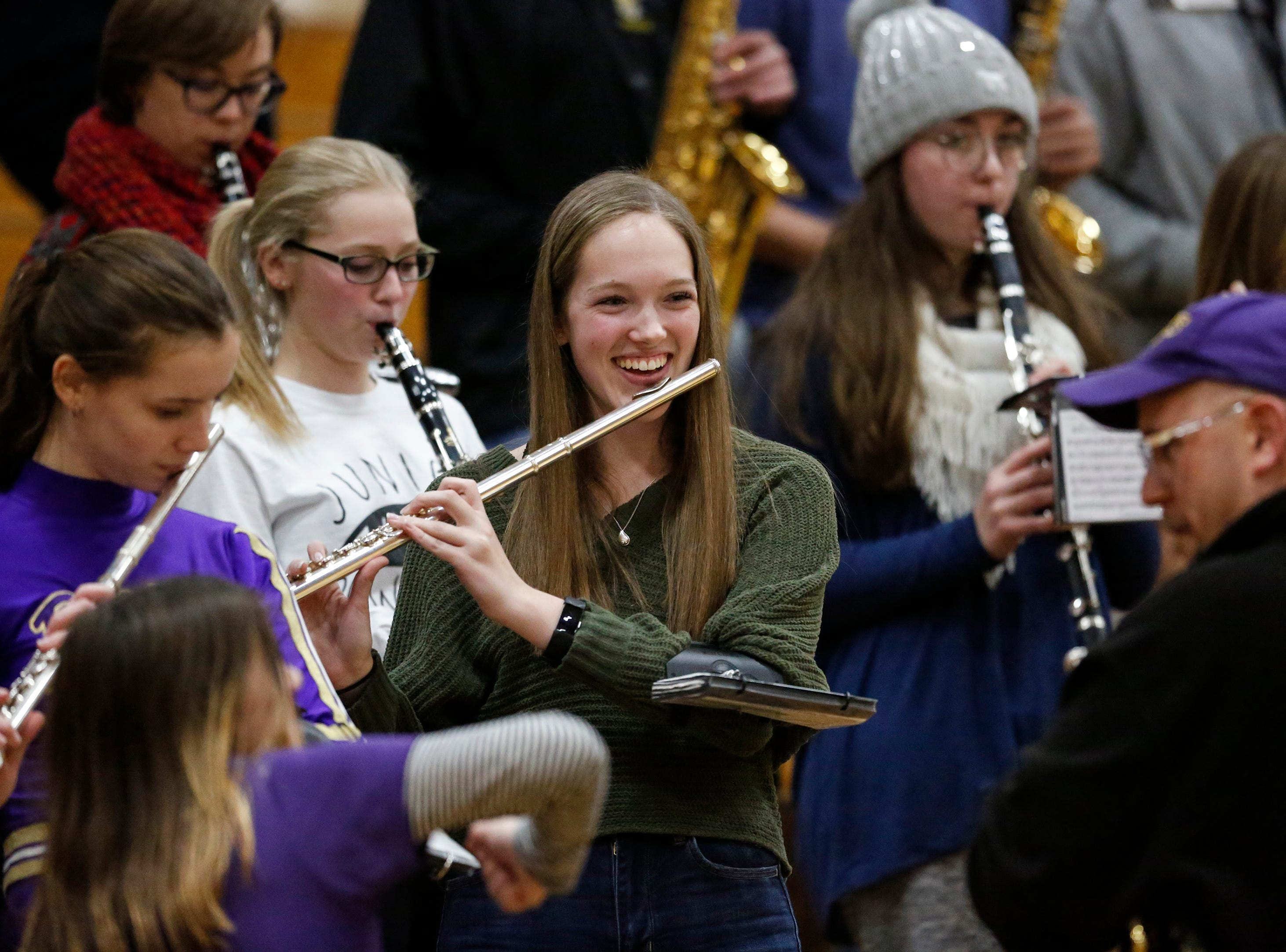 A member of the Two Rivers' band laughs at her band leader during a boys basketball game against Sheboygan Falls at Two Rivers High School Tuesday, December 4, 2018, in Two Rivers, Wis. Joshua Clark/USA TODAY NETWORK-Wisconsin