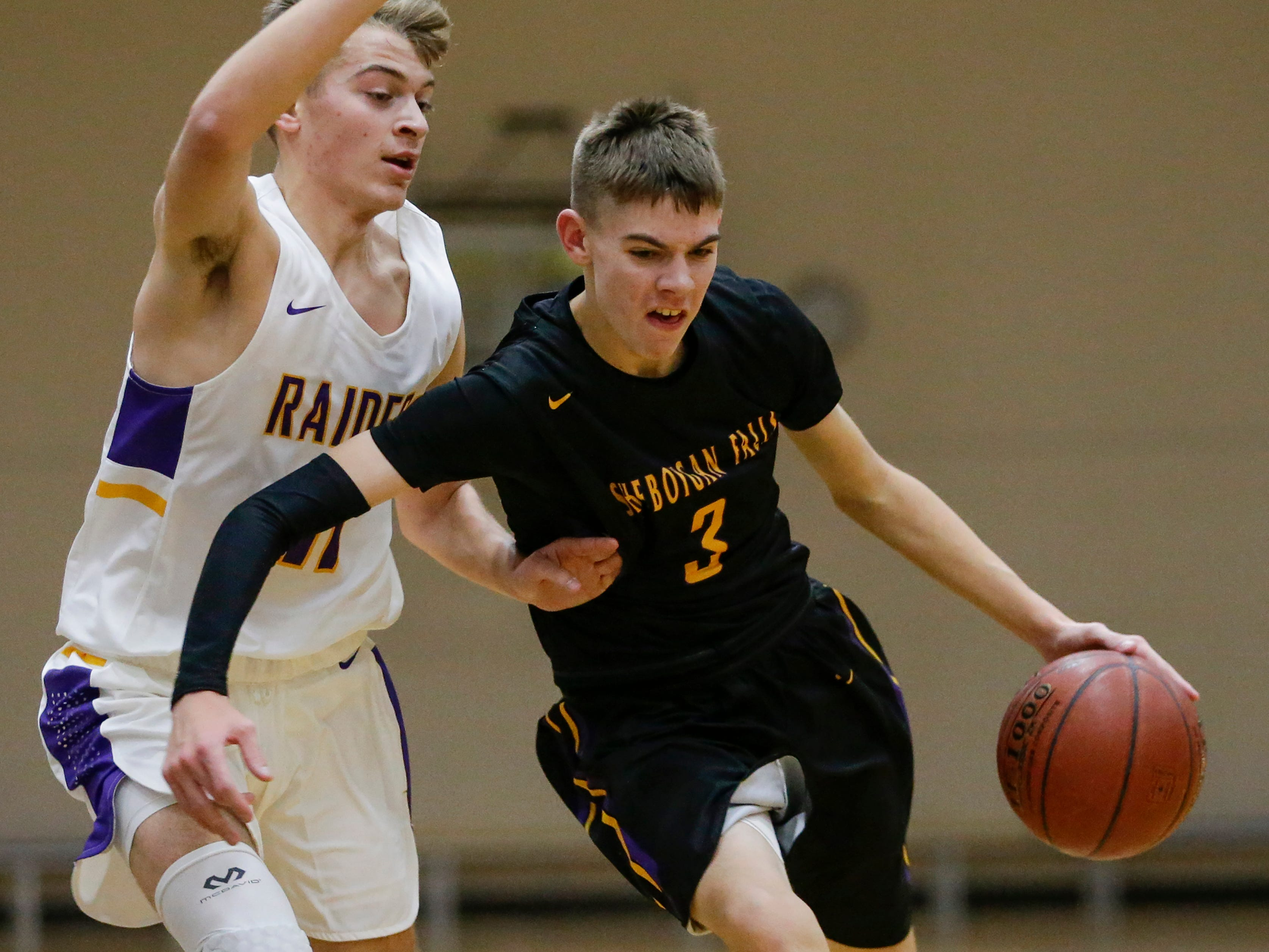 Sheboygan Falls' Jamison Nickolai drives to the basket against Two Rivers' Alexander Klein during an Eastern Wisconsin Conference game at Two Rivers High School Tuesday, December 4, 2018, in Two Rivers, Wis. Joshua Clark/USA TODAY NETWORK-Wisconsin