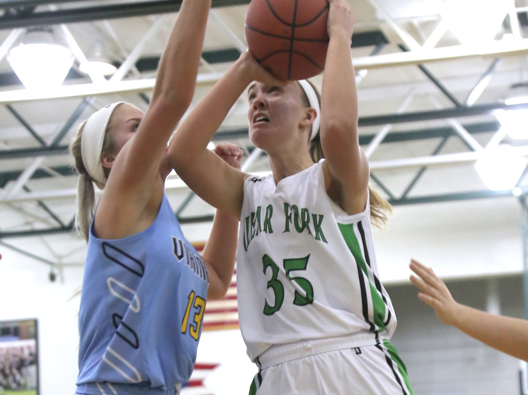Clear Fork's Alli Studenmund attempts a shot against River Valley's Ally Johnson on Tuesday.