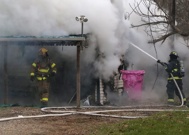 Multiple fire departments were called to a house fire on Lenox Avenue in Madison Township on Wednesday.