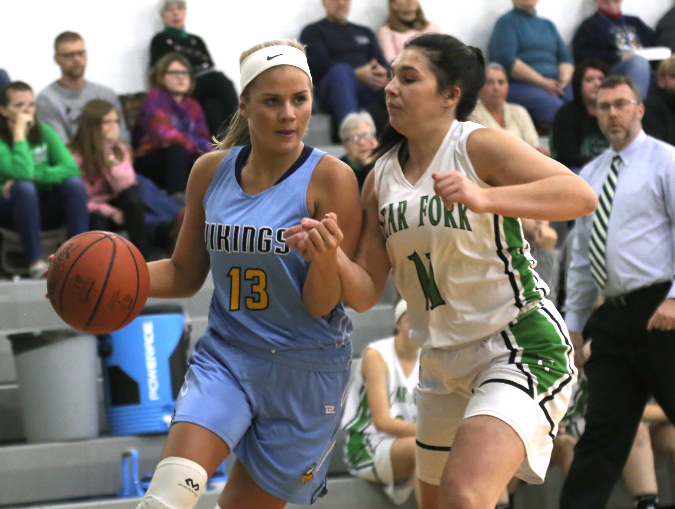 River Valley's Ally Johnson dribbles the ball against Clear Fork's Reagan Marshall on Tuesday.