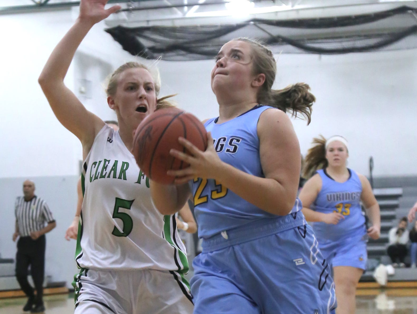 River Valley's Madi Lott attempts a shot against Clear Fork's Valerie Golden on Tuesday.