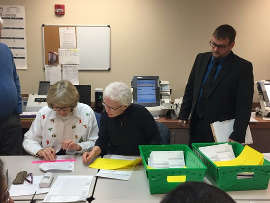 Jeff Ratliff, the Democrat who lost his bid for Marion County prosecutor in 2018, watches in December as a recount team tallies by hand votes on paper ballots.