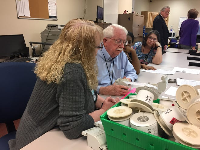 A four-person recount team, including Ed Shafer, review the log tapes from a voting machine Monday during a hand recount of votes in November's Marion County prosecutor's race.