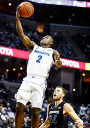 Memphis guard Alex Lomax (left) drives for a layup against South Dakota State defender Alex Arians (right) during action at the FedExFourm., Tuesday, December 4, 2018.