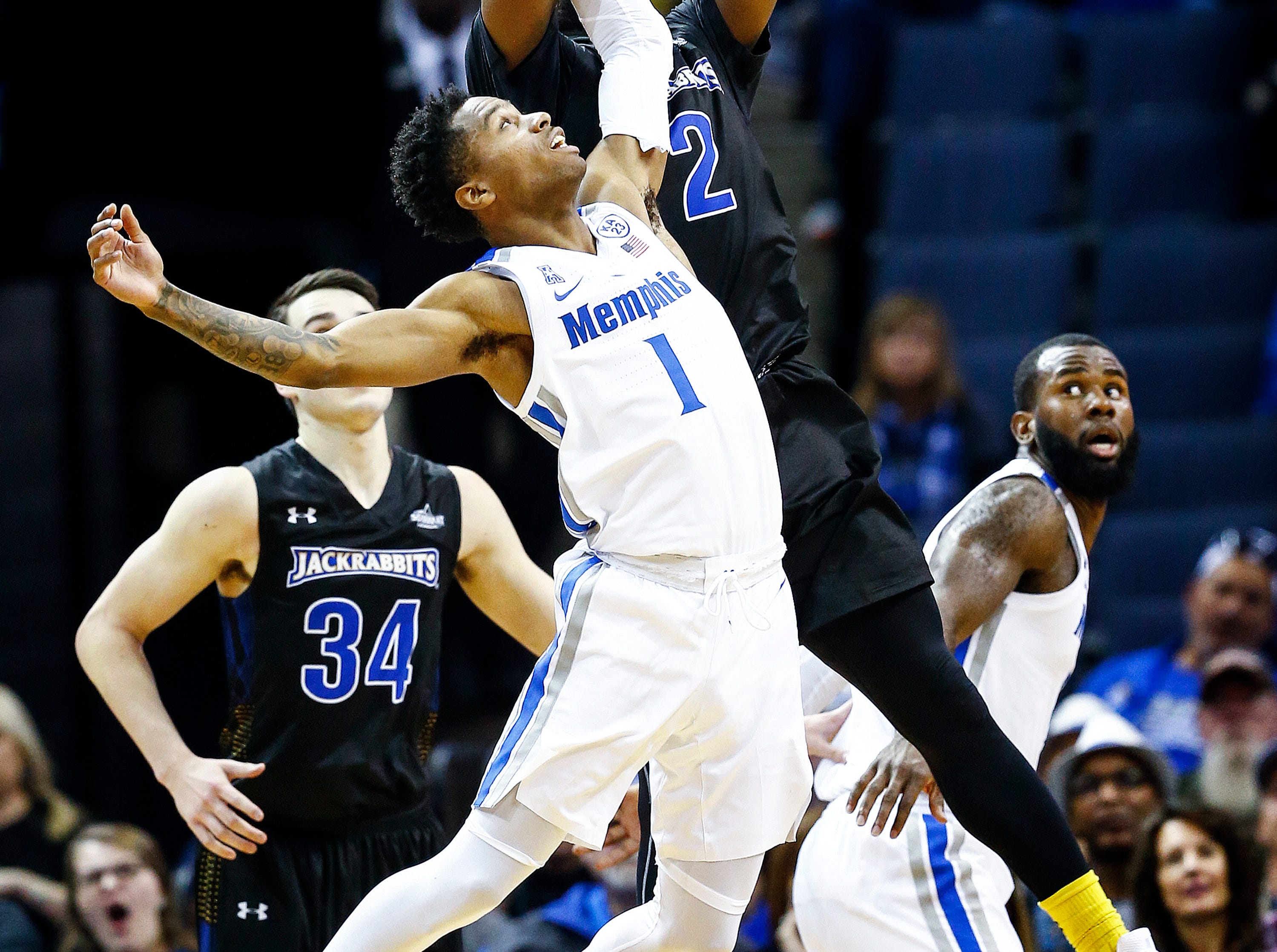 Memphis defender Tyler Harris (front) reaches for a steal against South Dakota State guard Tevin King (back) during action at the FedExFourm., Tuesday, December 4, 2018.