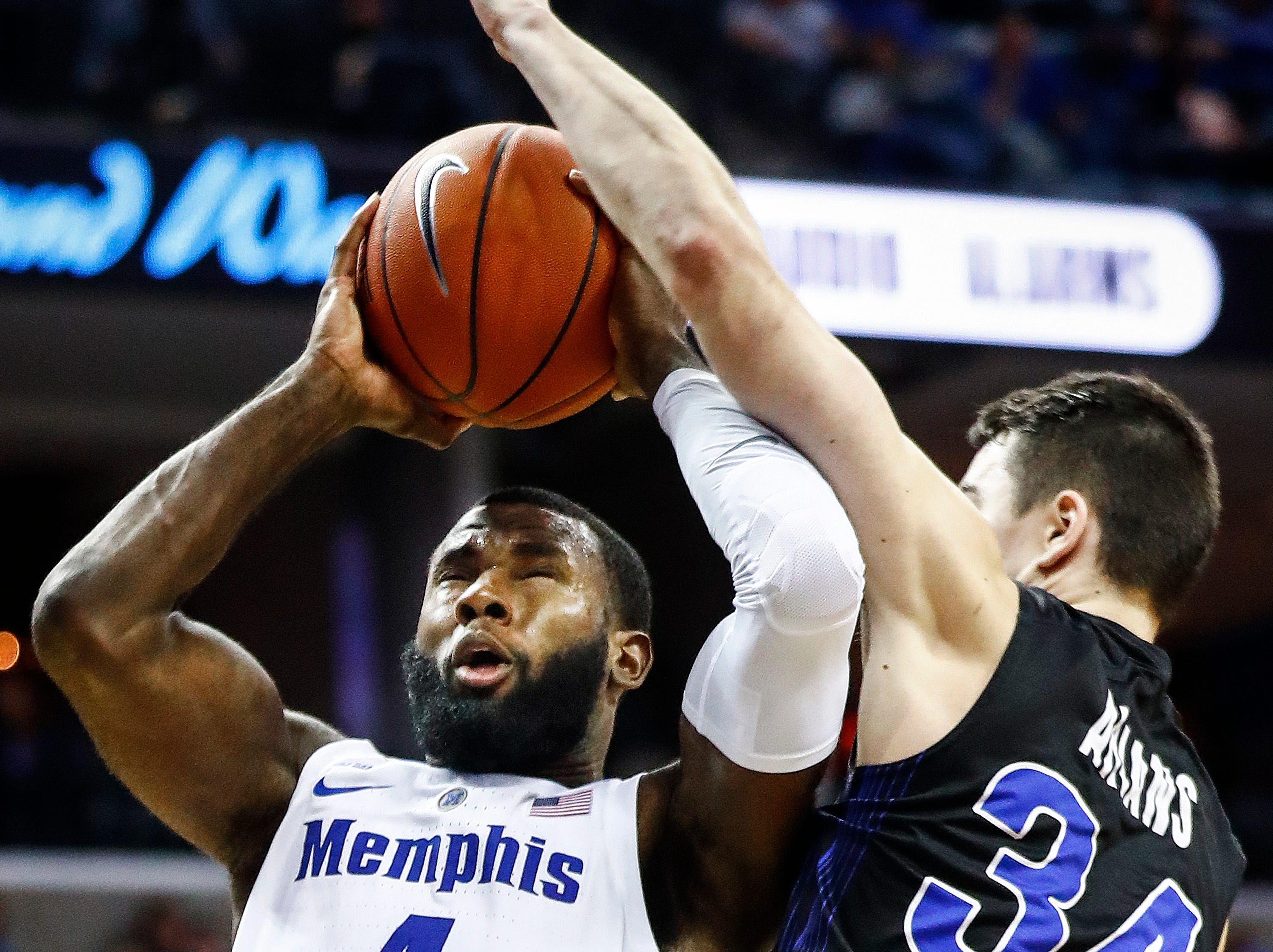 Memphis forward Raynere Thornton (left) drives for a lay-up while being fouled by South Dakota State defender Alex Arians (right) during action at the FedExFourm., Tuesday, December 4, 2018.
