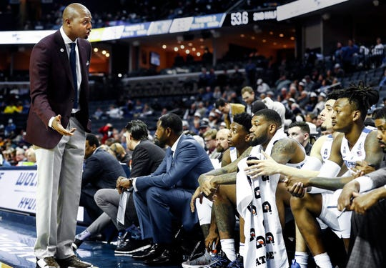Memphis head coach Penny Hardaway (left) talks to his bench players during action against South Dakota State at the FedExFourm., Tuesday, December 4, 2018.