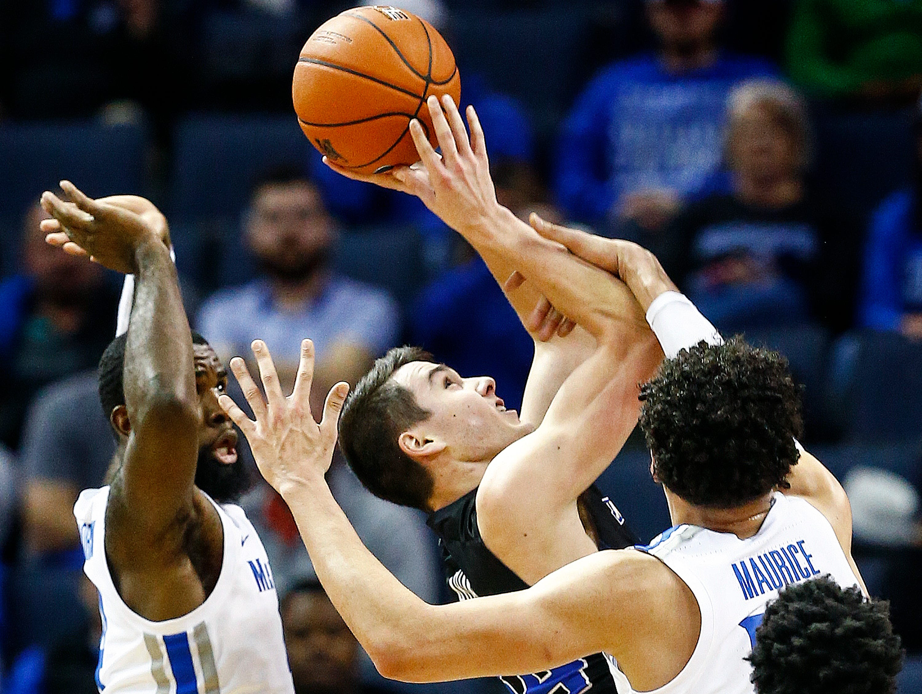 Memphis forward Isaiah Maurice (right) defends the shot of South Dakota State guard Owen King (middle) as teammate Raynere Thornton (left) helps on the play during action at the FedExFourm., Tuesday, December 4, 2018.