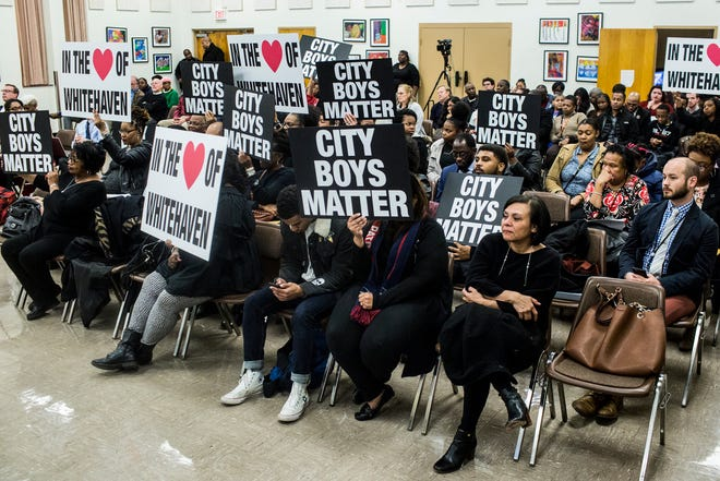 December 04 2018 - Supporters of  City University Boys Prep school hold signs during the public comment section of the Shelby County Schools School Board meeting on Tuesday.